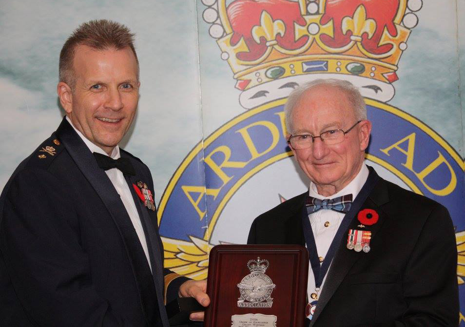 Major-General William Seymour presents Captain (retired) Grant Whitson from Calgary's 783 Wing with the RCAF Association's Order of Excellence in October 2016. Captain Whitson is the ninth person to be inducted into the order. PHOTO: Lieutenant-Colonel (retired) Dean Black, RCAFA
