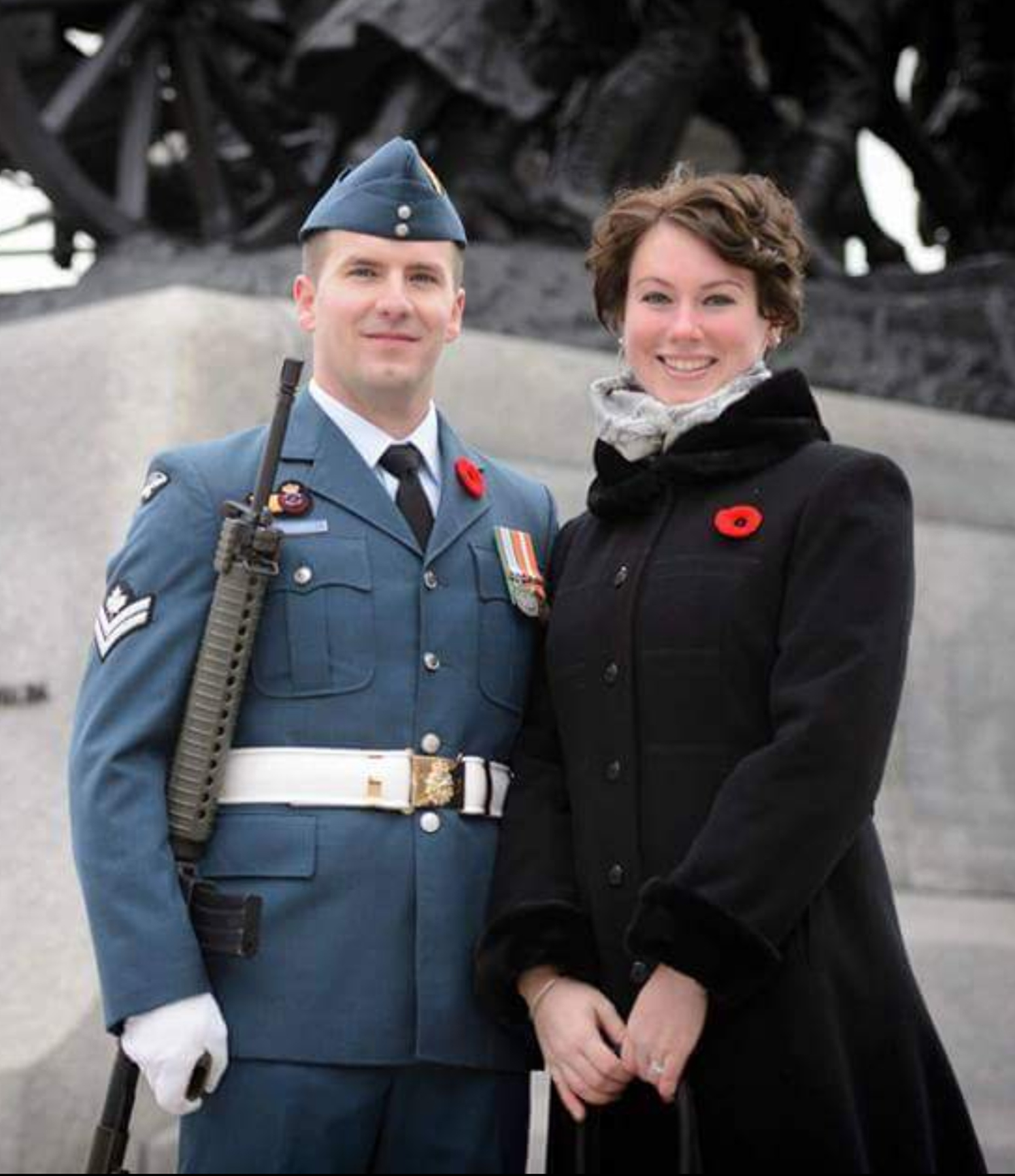 Royal Canadian Air Force Sentry Master Corporal George Arsenault and his wife, Emily, stand at the National War Memorial in Ottawa, Ontario, before the 2016 Remembrance Day Ceremony. PHOTO: Corporal Michael MacIsaac