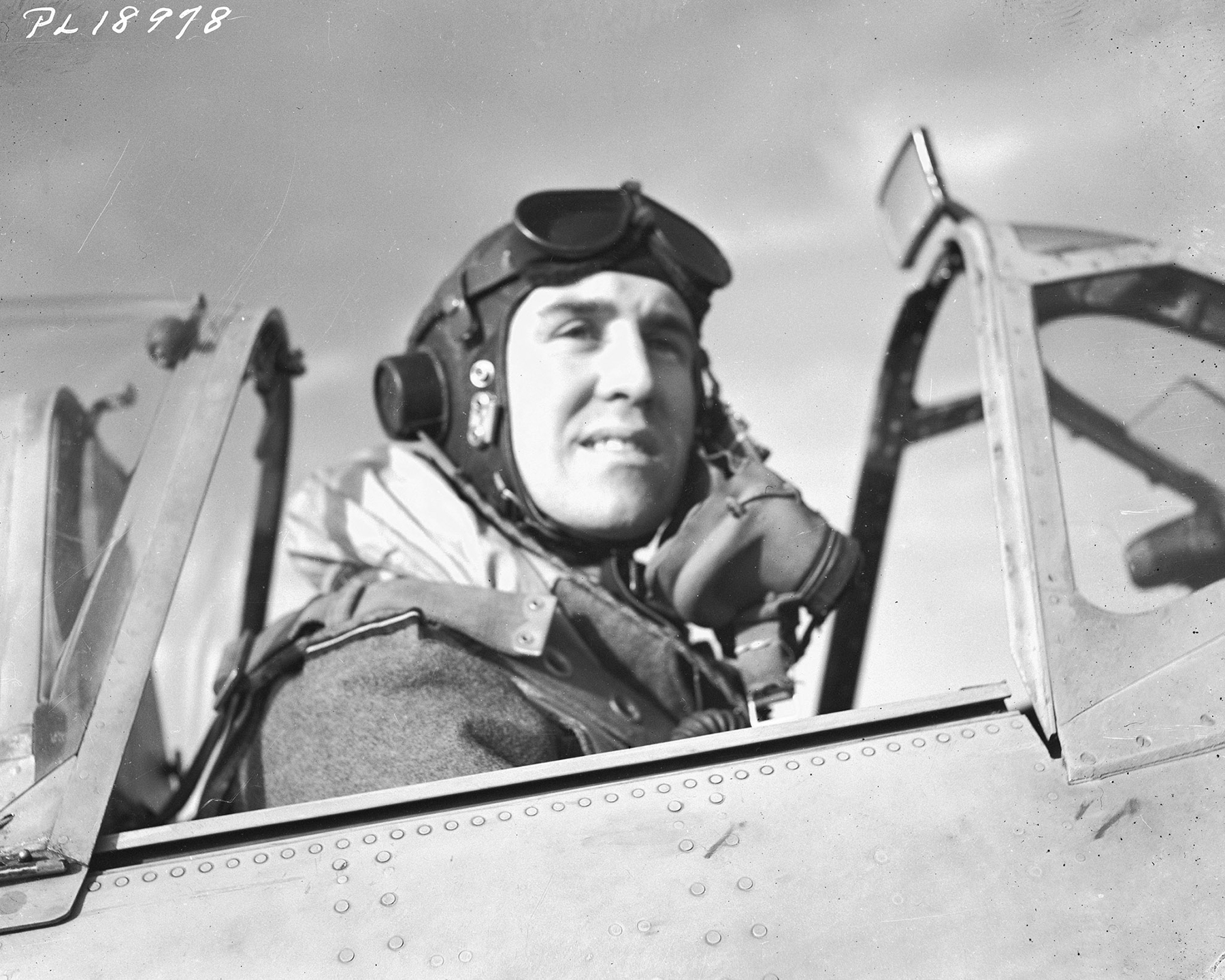"Flying Officer Cy Yarnell, from Toronto, Ontario, prepares for take-off with the Royal Air Force ""County of London"" Spitfire Squadron in Italy in January 1944. PHOTO: DND Archives, PL-18978"