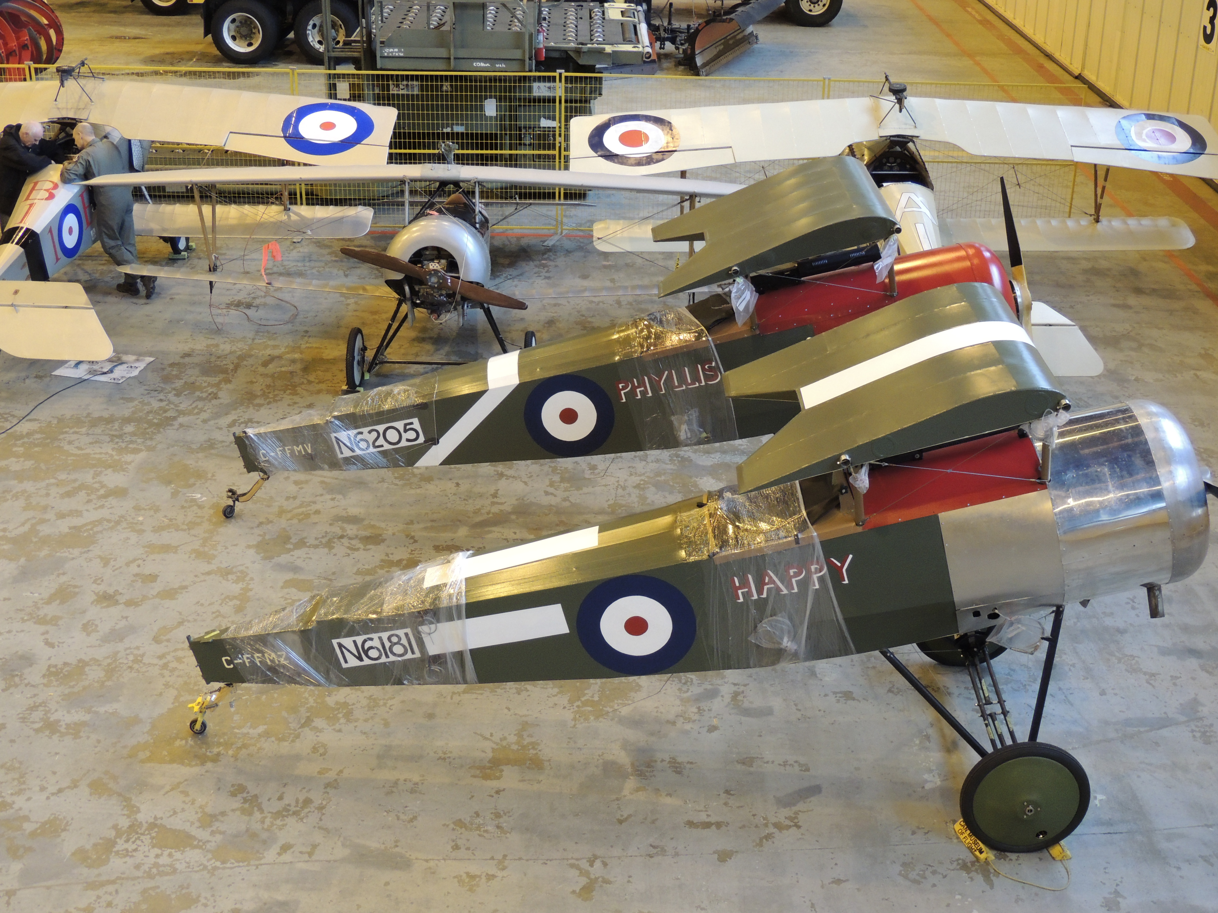 The Vimy Flight Association's two Sopwith Pups (in the foreground) are ready for loading onto an RCAF CC-177 Globemaster III aircraft for transport to France. The aircraft in the background are Nieuport XIs. PHOTO: Major Holly-Anne Brown