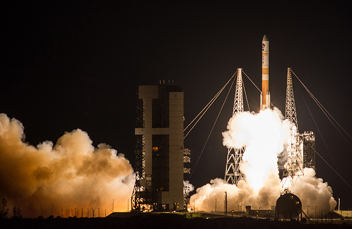 slide - A rocket lifts off.