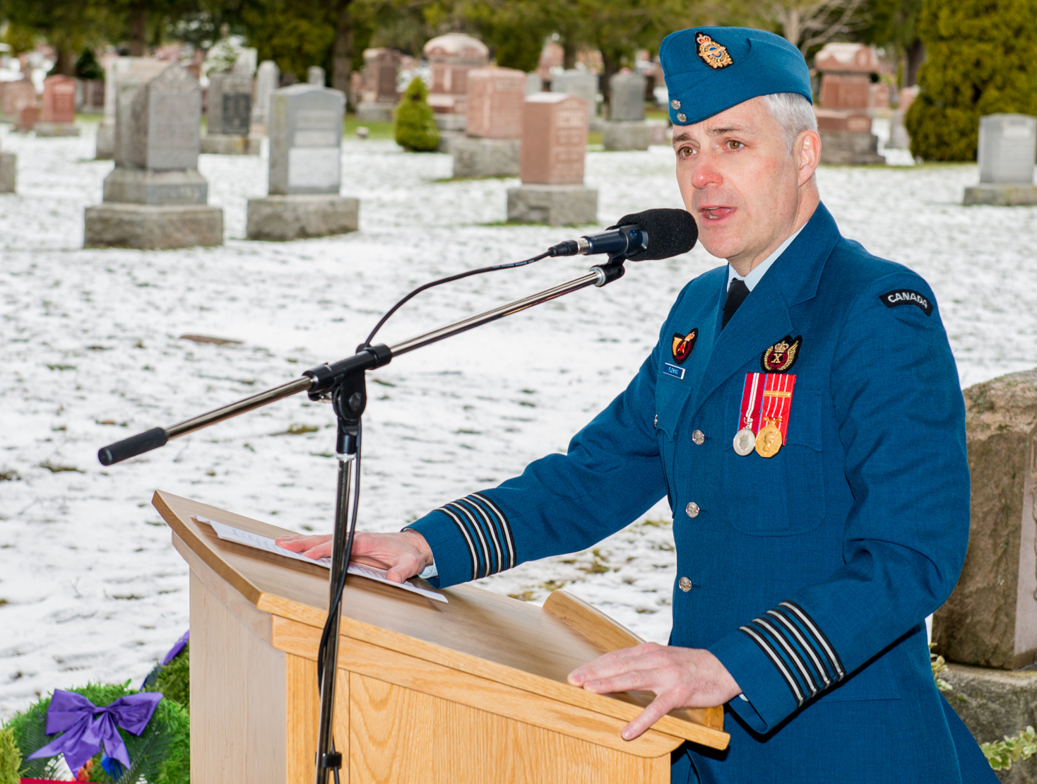 The commander of 16 Wing Borden, Colonel Andrew Fleming, addresses attendees at the ceremony commemorating Cadet James Talbot, the first casualty of the Royal Flying Corps Canada pilot training program, at Dorchester Union Cemetery, in Dorchester Ontario, on April 7, 2017. PHOTO: Corporal Aydyn Neifer, BM03-2017-0107-06