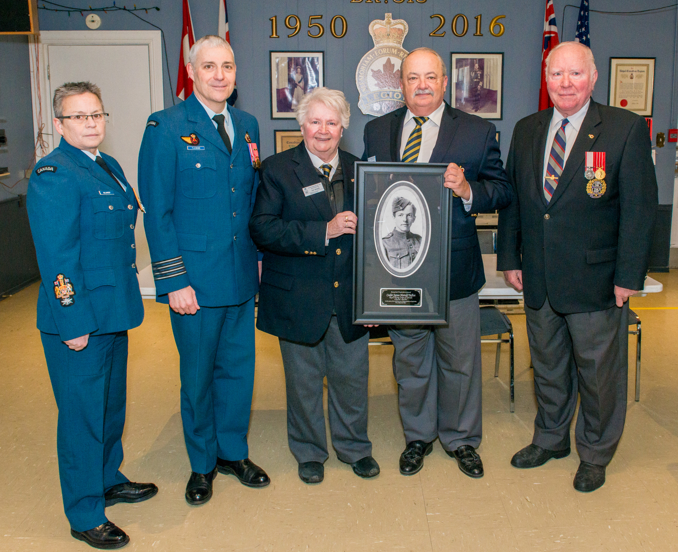 Following the ceremony honouring Cadet James Talbot, the 16 Wing Borden contingent was hosted by Royal Canadian Legion Dorchester Donnybrook Branch 513. At that time, the Legion branch was presented with a portrait of Cadet Talbot, a replica of the portrait that hangs in the Base Borden Military Museum. From left to right are Chief Warrant Officer Necole Belanger, Colonel Andrew Fleming, Pat Wonch, branch president, Shane Lynch, branch vice-president, and Robert Beamish, branch secretary. PHOTO: Corporal Aydyn Neifer, BM03-2017-0107-19