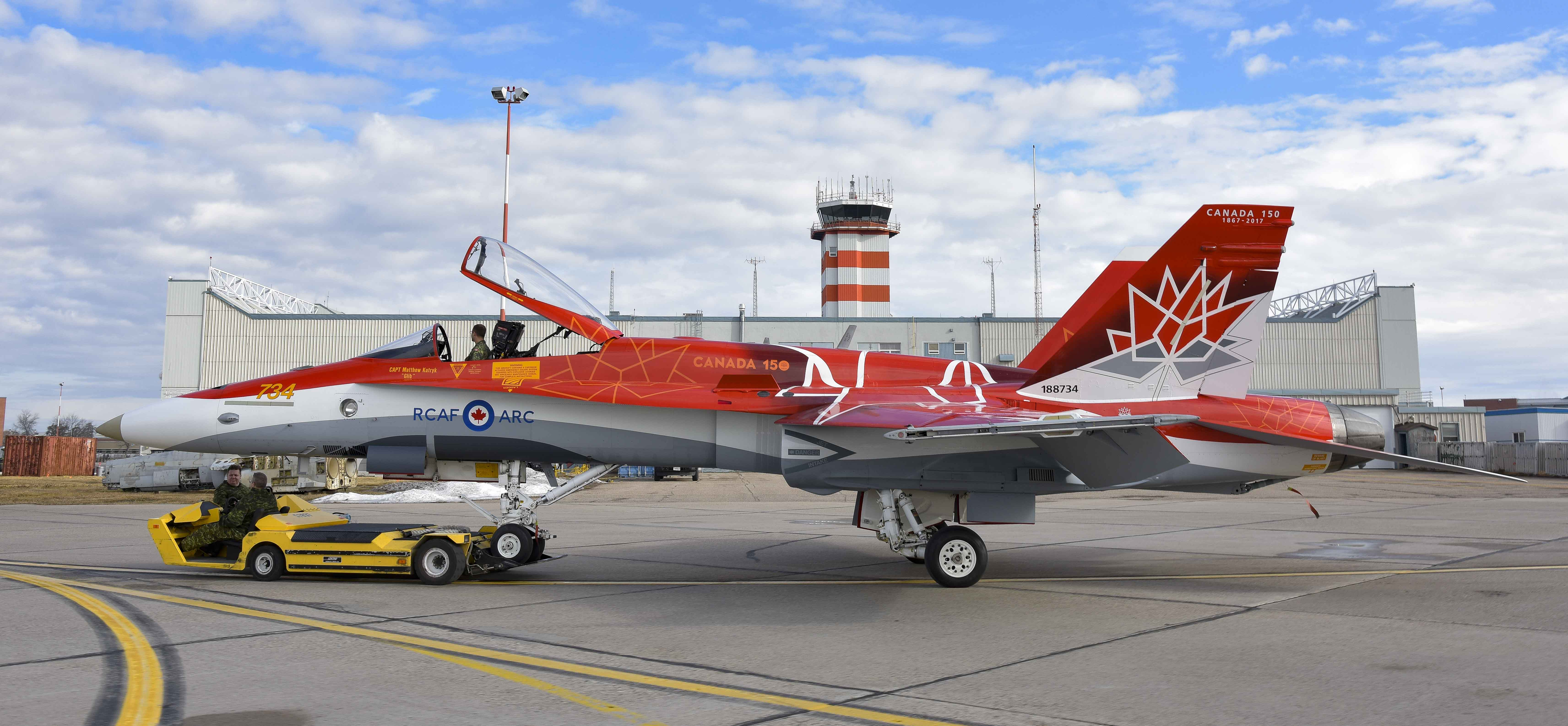 The 2017 Demonstration CF-18 Hornet aircraft is marshalled into position at 4 Wing Cold Lake, Alberta. The Demo Hornet's 2017 paint scheme celebrates the 150th anniversary of Canadian Confederation; the aircraft will be piloted by Captain Matthew Kutryk. PHOTO: Corporal Bryan Carter, CK05-2017-0264-001