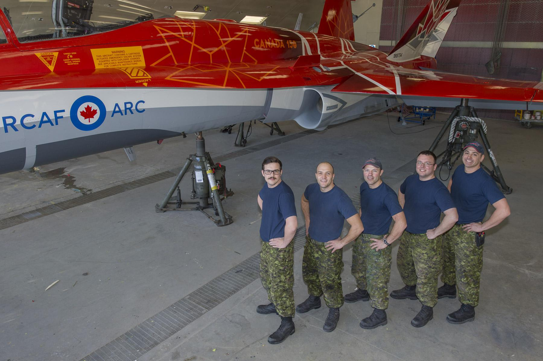 Members of 3 Air Maintenance Squadron pose for a group shot during the unveiling of the 2017 Demo Jet at 4 Wing, Cold Lake, Alberta. PHOTO: Corporal Bryan Carter, CK04-2017-0195-027