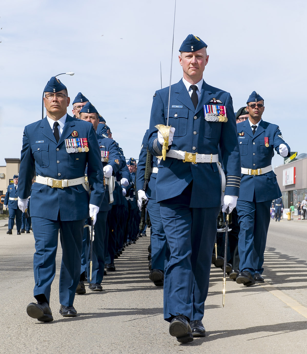 4 Wing Cold Lake commanding officer, Colonel Paul Doyle (front) and 4 Wing chief warrant officer CWO Alain Roy (left), lead wing personnel away from the Town of Bonnyville at the conclusion of the Freedom of the City for the Town of Bonnyville. 4 Wing Cold Lake was granted Freedom of the City for the Town of Bonnyville and Municipal District of Bonnyville, Alberta, on May 5, 2017. PHOTO: Corporal Justin Roy, CK07-2017-0343-008