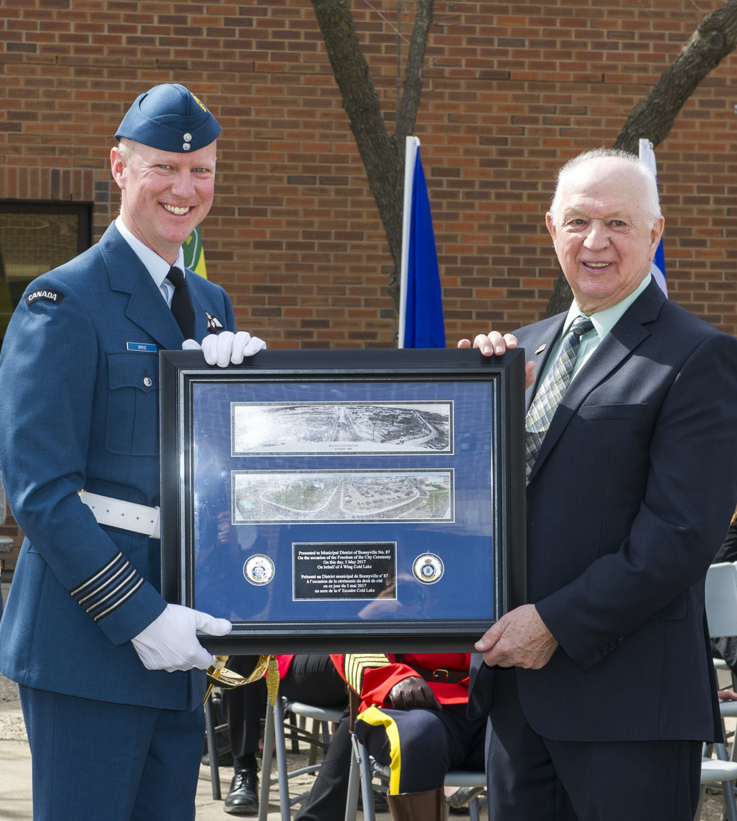 4 Wing Cold Lake commanding officer  Colonel Paul Doyle (left) presents Bonnyville, Alberta, town councillor Ray Prevost (right) with a gift on May 5, 2017, during the Freedom of the City for the Town of Bonnyville. 4 Wing Cold Lake was granted Freedom of the City for the Town of Bonnyville and Municipal District of Bonnyville, Bonnyville, Alberta. PHOTO: Corporal Justin Roy, CK07-2017-0343-007