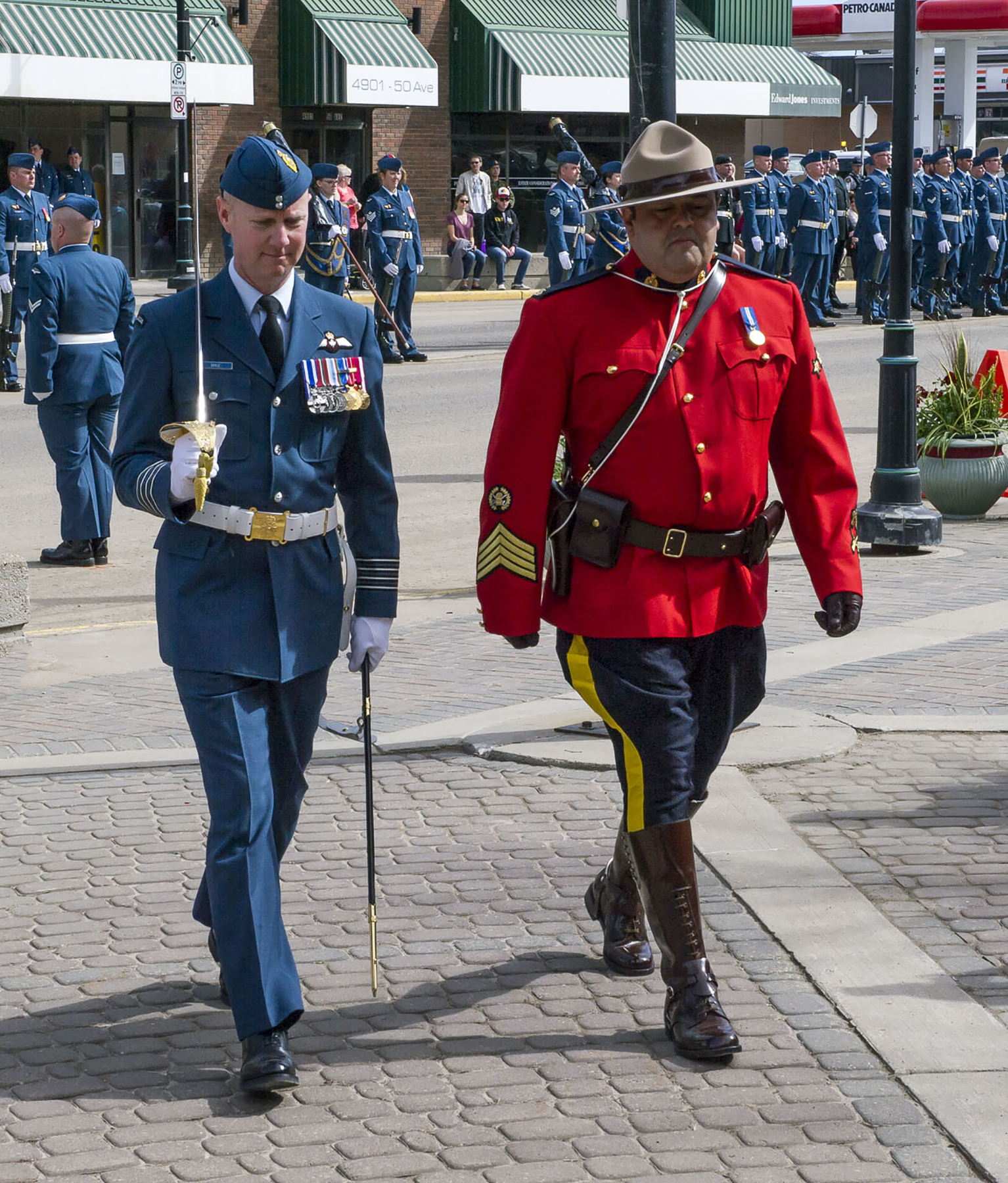 On May 5, 2017, Royal Canadian Mounted Police detachment commander Staff Sergeant Luis Gandolfi escorts 4 Wing Cold Lake, Alberta, commanding officer Colonel Paul Doyle to the Town of Bonnyville building, where, on behalf of 4 Wing, Colonel Doyle accepted the Freedom of the City for the Town of Bonnyville and Municipal District of Bonnyville, Alberta. PHOTO: Corporal Justin Roy, CK07-2017-0343-001