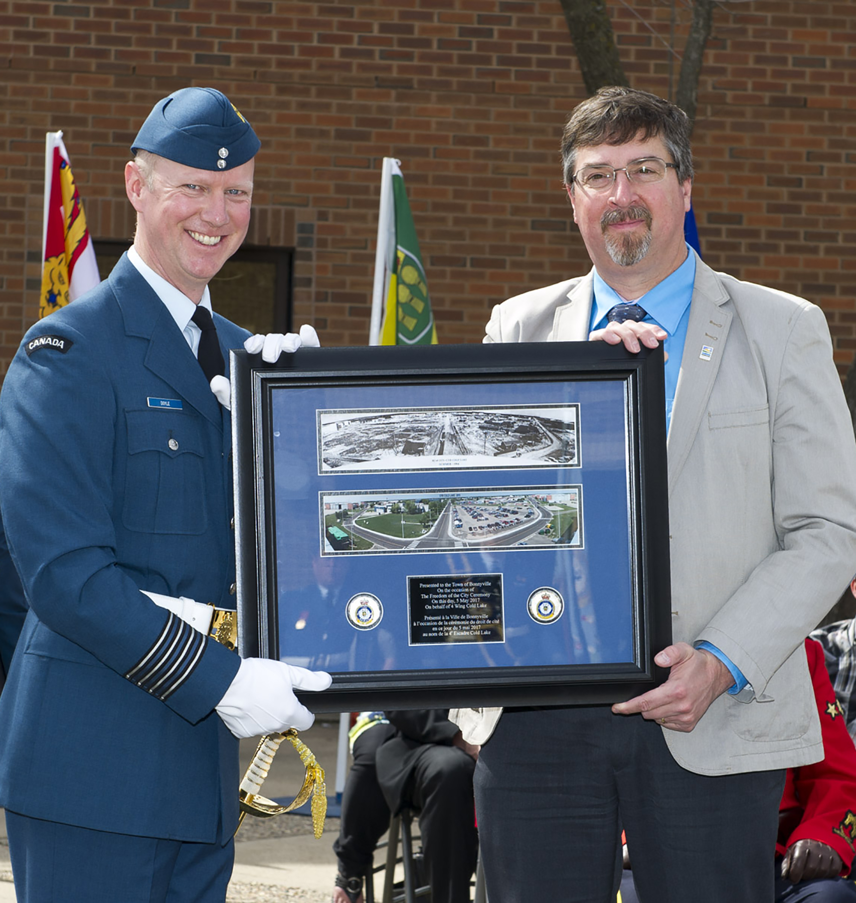 4 Wing Cold Lake, Alberta, commanding officer Colonel Paul Doyle presents Mayor of Bonnyville, Alberta, Gene Sobolewski with a gift during the Freedom of the City for the Town of Bonnyville on May 5, 2017. 4 Wing was granted Freedom of the City for the Town of Bonnyville and the Municipal District of Bonnyville, Alberta. PHOTO: Corporal Justin Roy, CK07-2017-0343-006