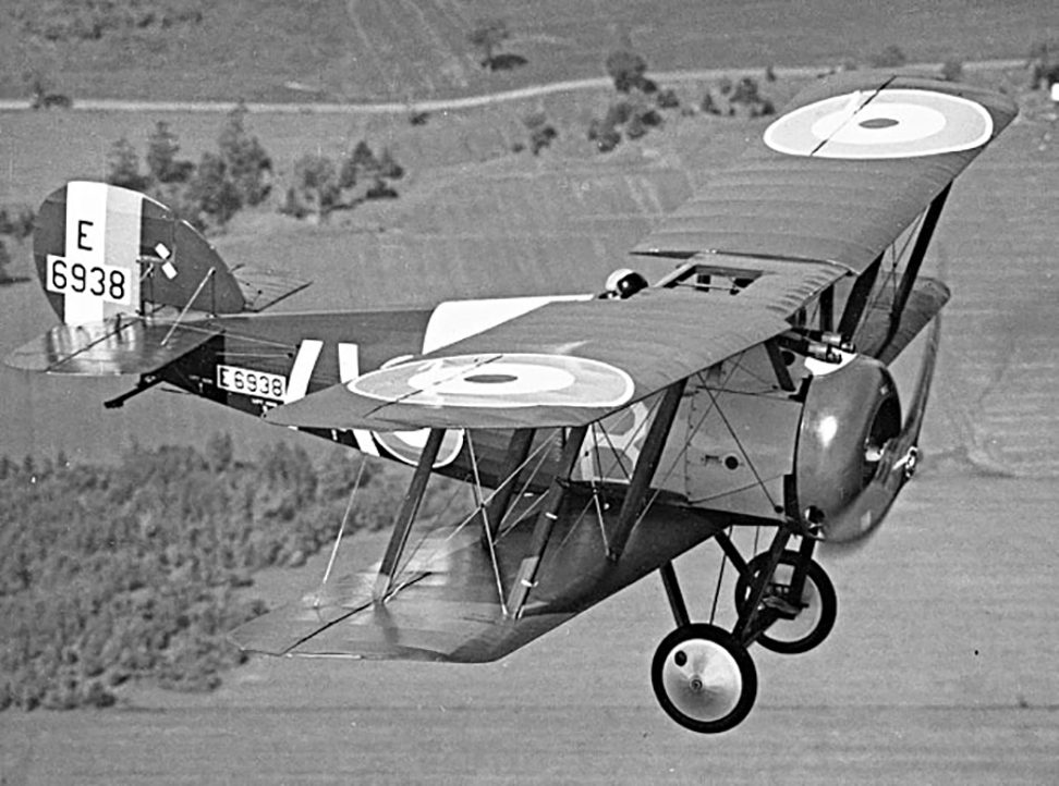 Wing Commander Dave Wightman flies the beautiful Sopwith Snipe over parkland near RCAF Station Rockcliffe, Ontario, just east of Ottawa, wearing his RCAF bone dome helmet after witnessing the injury sustained by fellow pilot Bill Long in a Nieuport 17. In this 1967 photograph, we see the excellent range of vision afforded the pilot of a Snipe, who sat rather high in the airframe and had the benefit of a cutout in the upper wing to further improve visibility. This Snipe was manufactured in 1918 by Nieuport and General Aircraft Limited of England. Details of its RAF history remain unknown, although it probably served abroad, as did most RAF Snipes. PHOTO: Canada Aviation and Space Museum