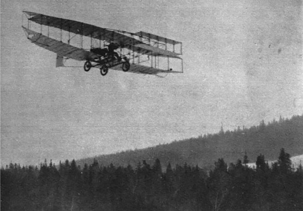 On February 23, 1909, in Canada's first powered distance flight, Canadian airman J.A.D. McCurdy pilots the Silver Dart above the frozen surface of Bras d'Or Lake in Cape Breton, Nova Scotia. PHOTO: Archived