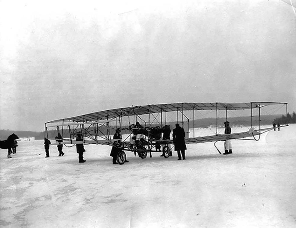 Airmen of the RCAF ready the Silver Dart replica on the frozen surface of Bras d'Or Lake, Cape Breton, Nova Scotia, on February 23, 1959. Wing Commander Paul Hartman flew the replica on the 50th anniversary of the first powered distance flight in Canada. The pilot of the original Silver Dart, J.A.D. McCurdy, was on hand to witness the re-enactment and shake Hartman's hand. PHOTO: Flight Magazine, March 6, 1959