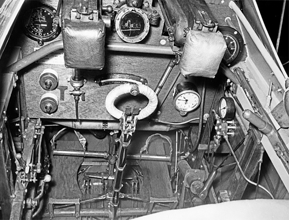 "The primitive cockpit of the Sopwith Snipe with the complicated engine control levers at lower left and the ""blip"" switch in the centre of the circular spade grip. PHOTO: Canada Aviation and Space Museum"