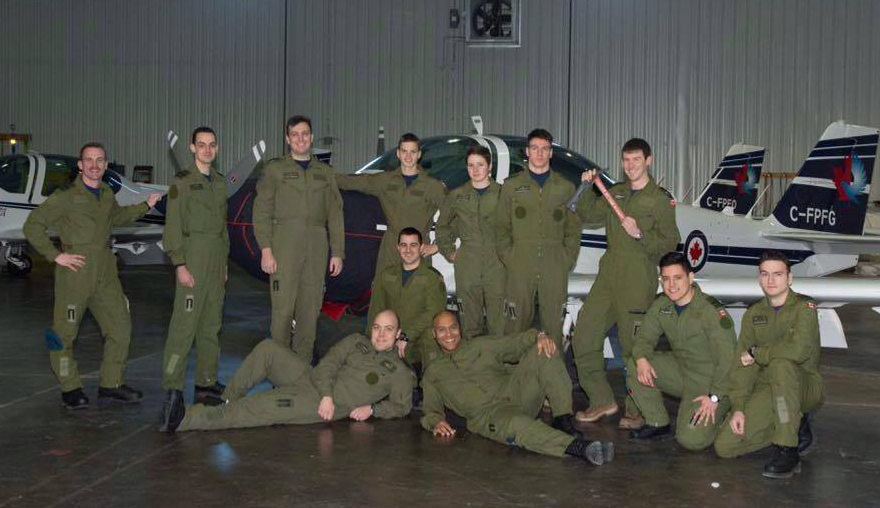 Primary Flying Training course 1701 from left to right, first row lying down: Second Lieutenant Jordan Kapp and Second Lieutenant Fabrice Dourlent. Second row kneeling, left to right:  Second Lieutenant Garret Sowchuk, Second Lieutenant Sebastien Moreno and Second Lieutenant Yannick Côté. Back row, left to right:  Second Lieutenant Kyle Pelkey, Second Lieutenant Dan Barlow, Second Lieutenant Kurtis McConnell, Second Lieutenant Todd Walsh, Second Lieutenant Emily McConnell, Second Lieutenant Benjamin Cournoyer and Second Lieutenant Colin Mark