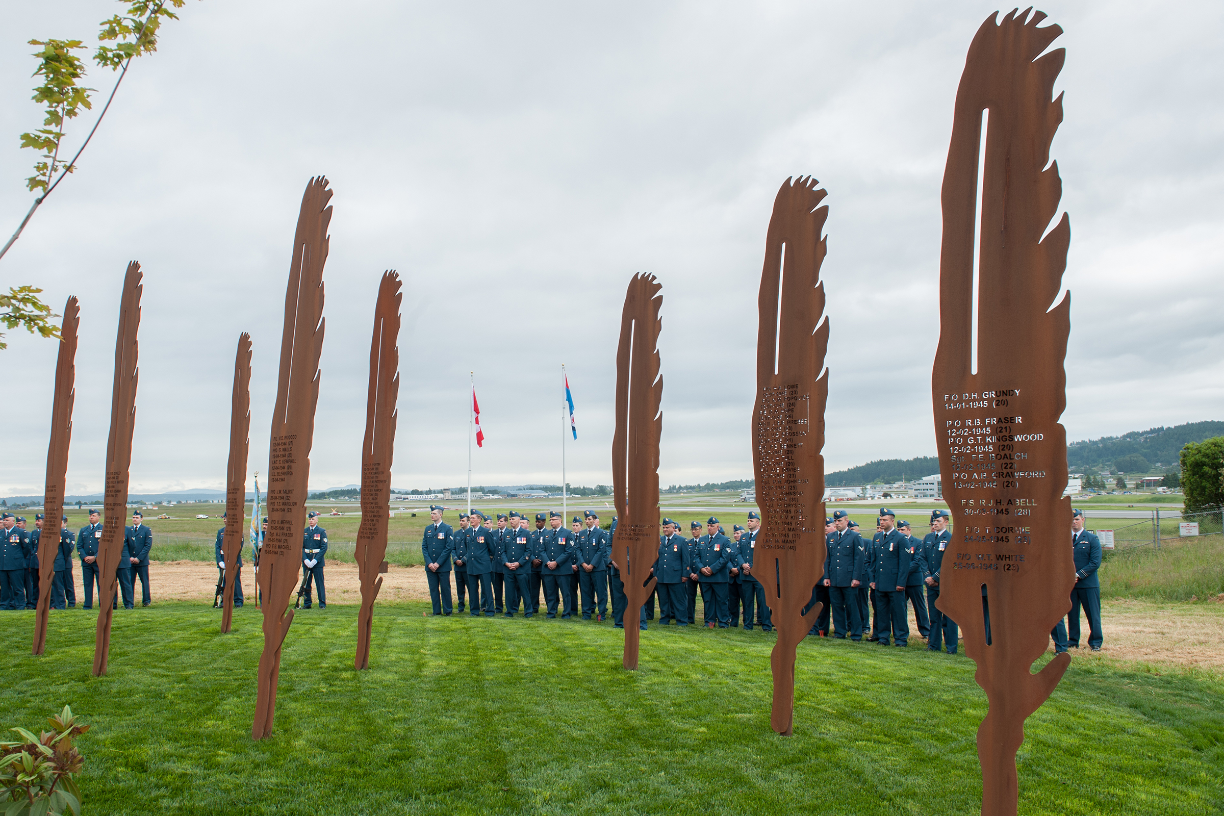 "Members of 443 Maritime Helicopter Squadron on parade during the dedication of the ""Lost Airmen of the Empire"" memorial at Victoria international Airport on June 1, 2017. The names of those who died while training or working as part of the British Commonwealth Air Training Plan at Patricia Bay are cut into the steel feathers. PHOTO: Master Corporal Chris Ward, ET2017-0159-02"