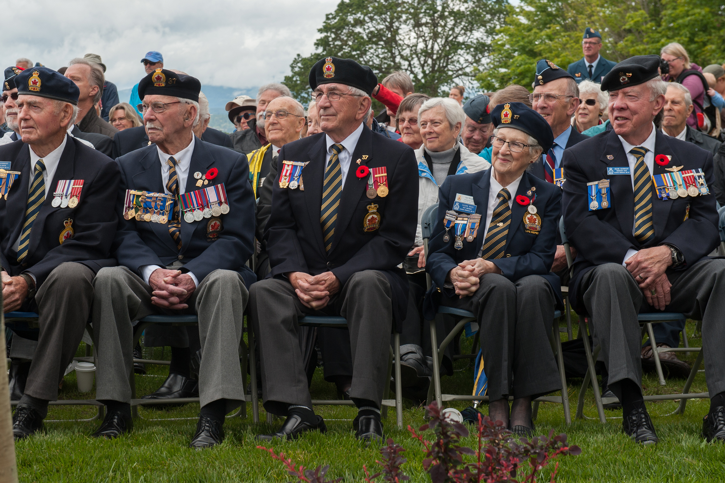 "Veterans listen to speakers during the dedication of the ""Lost Airmen of the Empire"" memorial at Victoria international Airport on June 1, 2017. PHOTO: Master Corporal Chris Ward, ET2017-0159-03"
