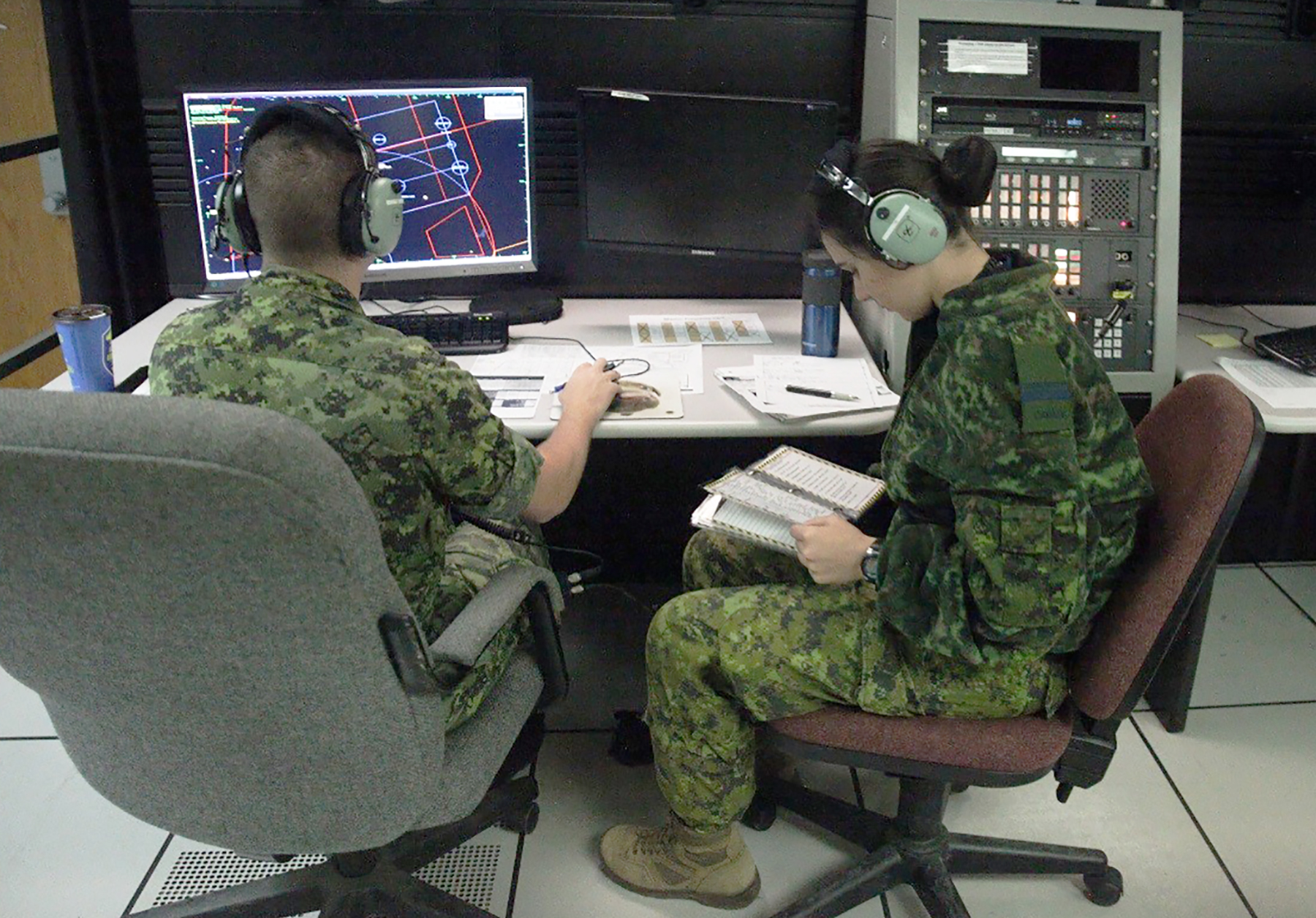 Lieutenant Kevin Bowen and Lieutenant Ashley Zen, Royal Canadian Air Force air battle managers with 42 Radar Squadron, 4 Wing Cold Lake, Alberta, direct aircraft on May 31, 2017, during Exercise Maple Flag 50 at 4 Wing. PHOTO: 2nd Lieutenant Stephanie Leguizamon, USMC