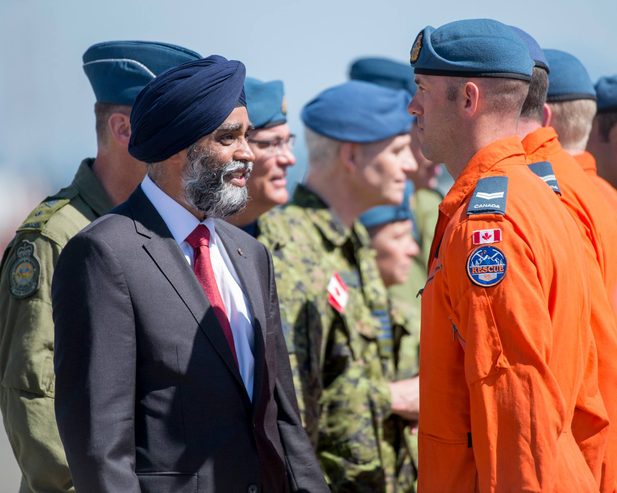 Defence Minister Harjit Sajjan speaks with graduates of Canada's 50th search and rescue technician course at Comox, British Columbia, on July 6, 2017. PHOTO: Master Seaman Roxanne Wood