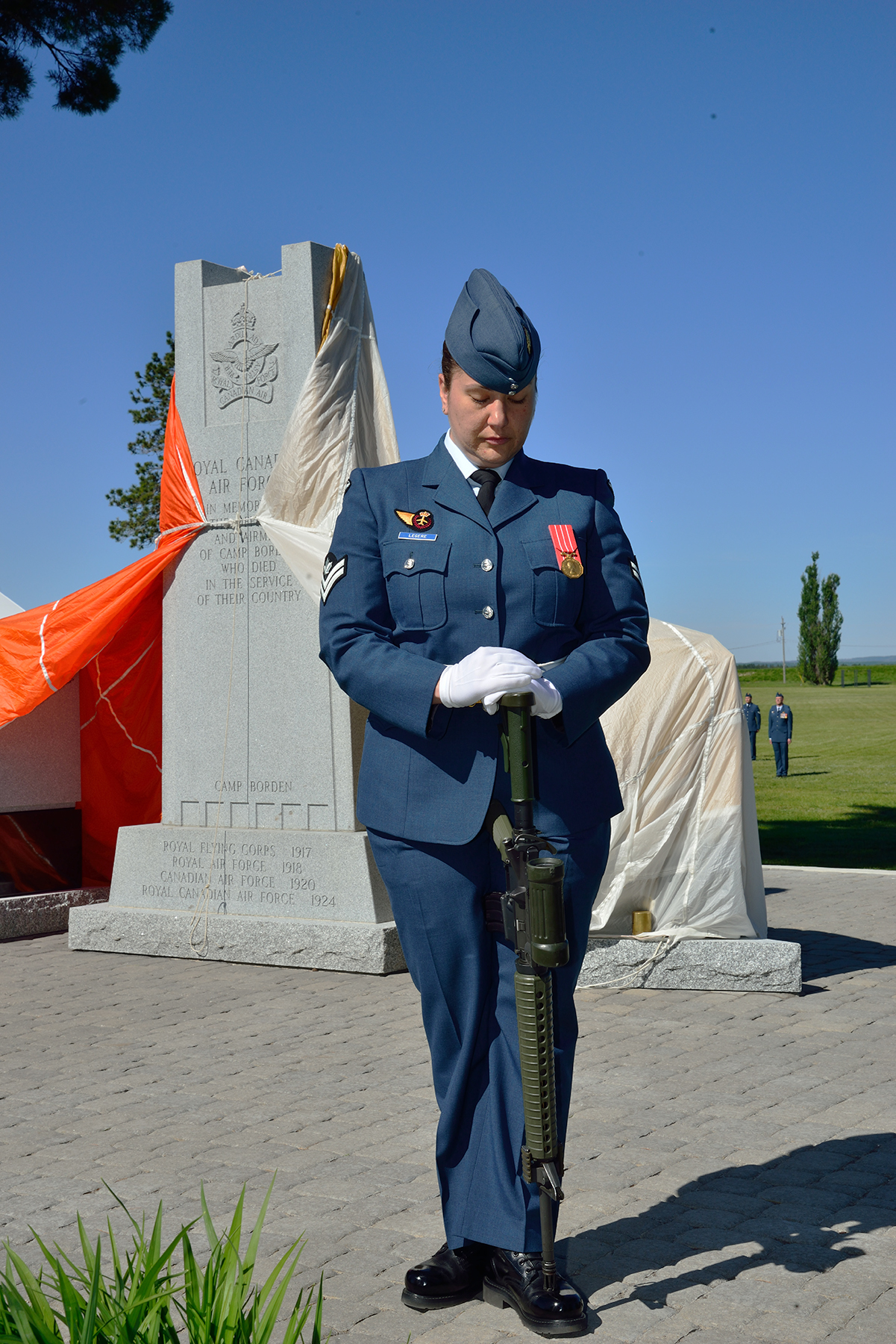 Master Corporal Lillian Legere stands sentry behind the newly rebuilt Royal Canadian Air Force Memorial at 16 Wing/Canadian Forces Base Borden, Ontario, before the unveiling parade on June 3, 2017. PHOTO: Sergeant Christopher Bentley, BM01-2017-0174-09