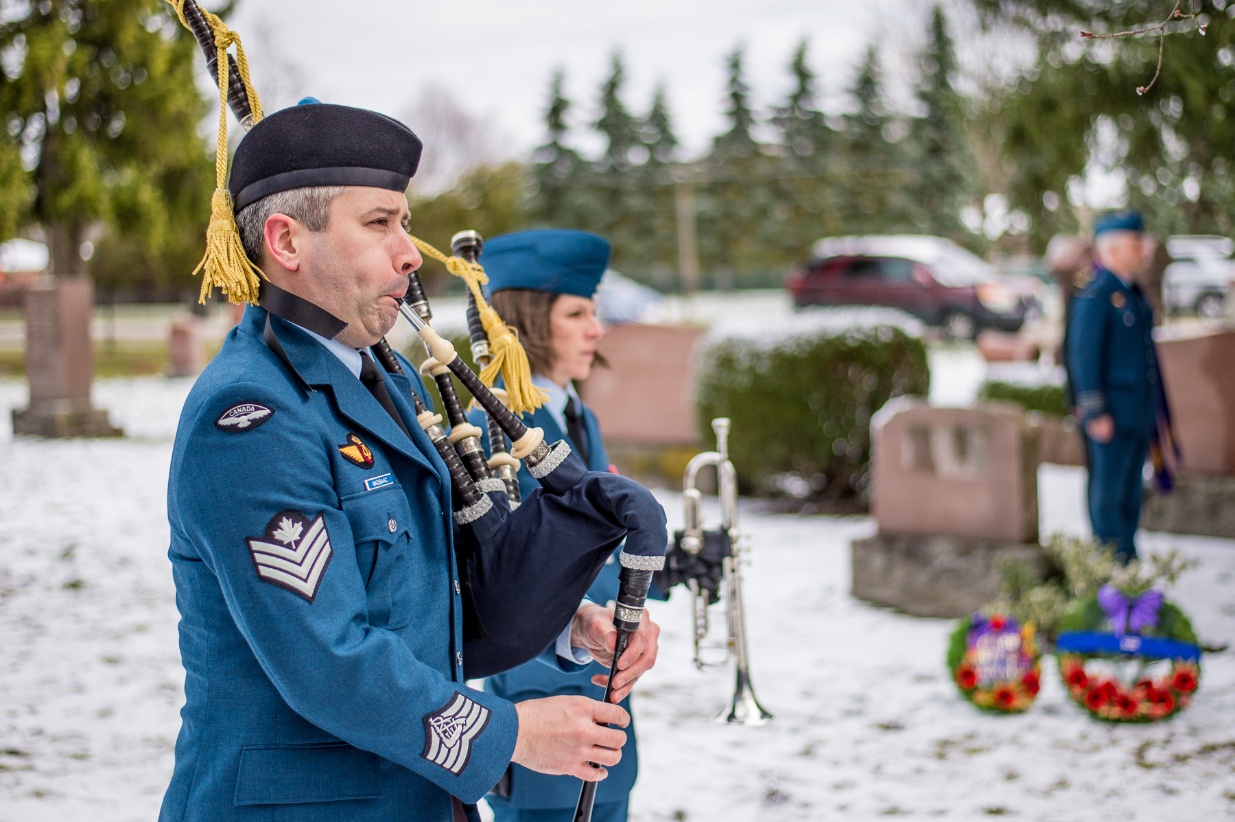 Piper Sergeant Matthew MacIsaac plays Lament on the bagpipes during the April 7, 2017, ceremony at Dorchester Union Cemetery, in Dorchester, Ontario, commemorating the 100th anniversary of the death of Cadet James Harold Talbot, the first casualty of Military Flying in Canada, who died in a flight training accident on April 8, 1917. PHOTO: Corporal Aydyn Neifer, BM03-2017-0107-25