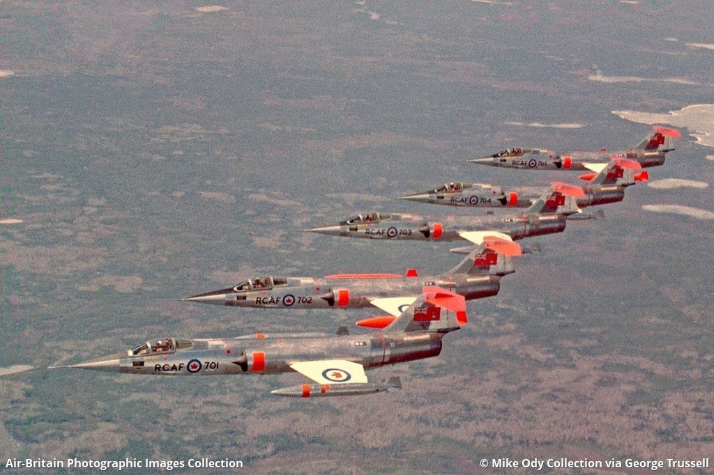 RCAF CF-104s Nos. 701 to 705 fly in formation over rough terrain in an undated photograph. PHOTO: Mike Ody Collection