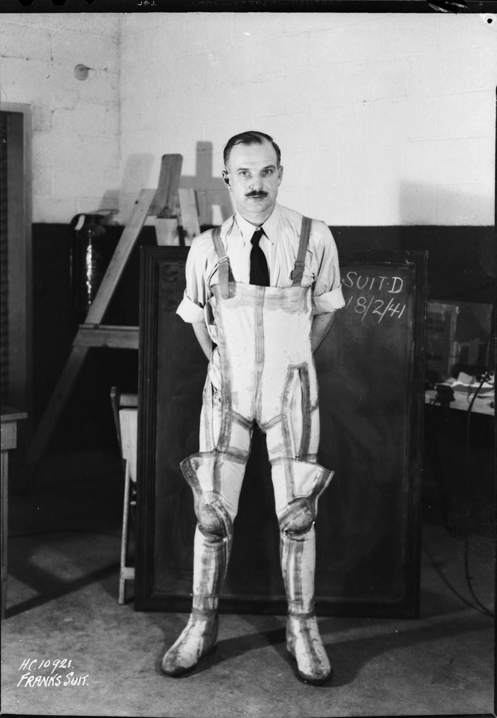In a February 18, 1941, photograph, Wilbur Franks models the G-suit (D), that he designed and fabricated at the University of Toronto, Ontario. PHOTO: Library and Archives Canada, MIKAN 3581726