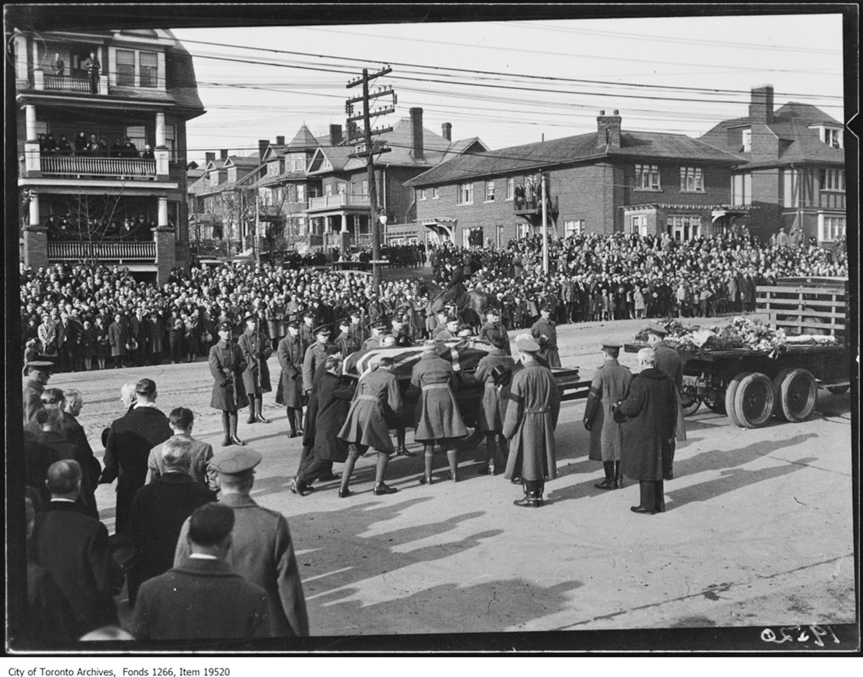 Military and civilian men place the coffin of Wing Commander William Barker onto the hearse that will carry it through the streets of Toronto to his final resting place. Wing Commander Barker, who flew with the Royal Flying Corps during the First World War, died in a tragic accident on March 12, 1930. His state funeral, witnessed by 50,000, was the largest the city had ever seen. He was interred in Mount Pleasant Cemetery, where a monument in his honour was dedicated in 2011. Wing Commander Barker was, and remains, Canada's most decorated war hero. PHOTO: City of Toronto Archives, Fonds 1266, Globe and Mail fonds