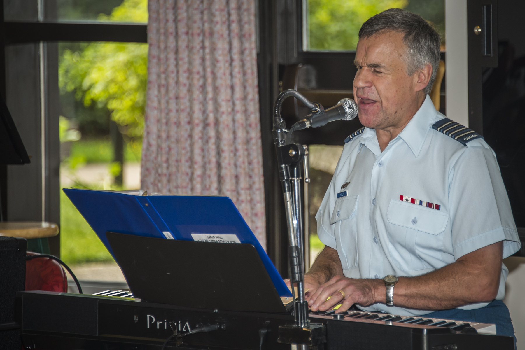 "14 Wing Greenwood Honorary Colonel Terry Kelly performs ""A Pittance of Time"" during his visit with Camp Hill Veterans' Hospital residents on August 20, 2017, in Halifax, Nova Scotia. PHOTO: Corporal Trevor Matheson, GD08-2017-0500-001"