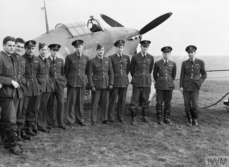 A group of pilots from the RCAF's No. 1 Squadron gather around one of their Hawker Hurricane Mk 1s at Prestwick, Scotland, on October 30, 1940. Squadron Leader Ernest A. McNab, commanding officer, stands fifth from the right. No. 1 Squadron fought in the Battle of Britain from August 16, 1940, until October 9, 1940, when the squadron was reassigned from 11 Group to 13 Group and the relatively quiet skies of Scotland to receive the rest they so desperately needed. PHOTO: © Imperial War Museum, CH 1733