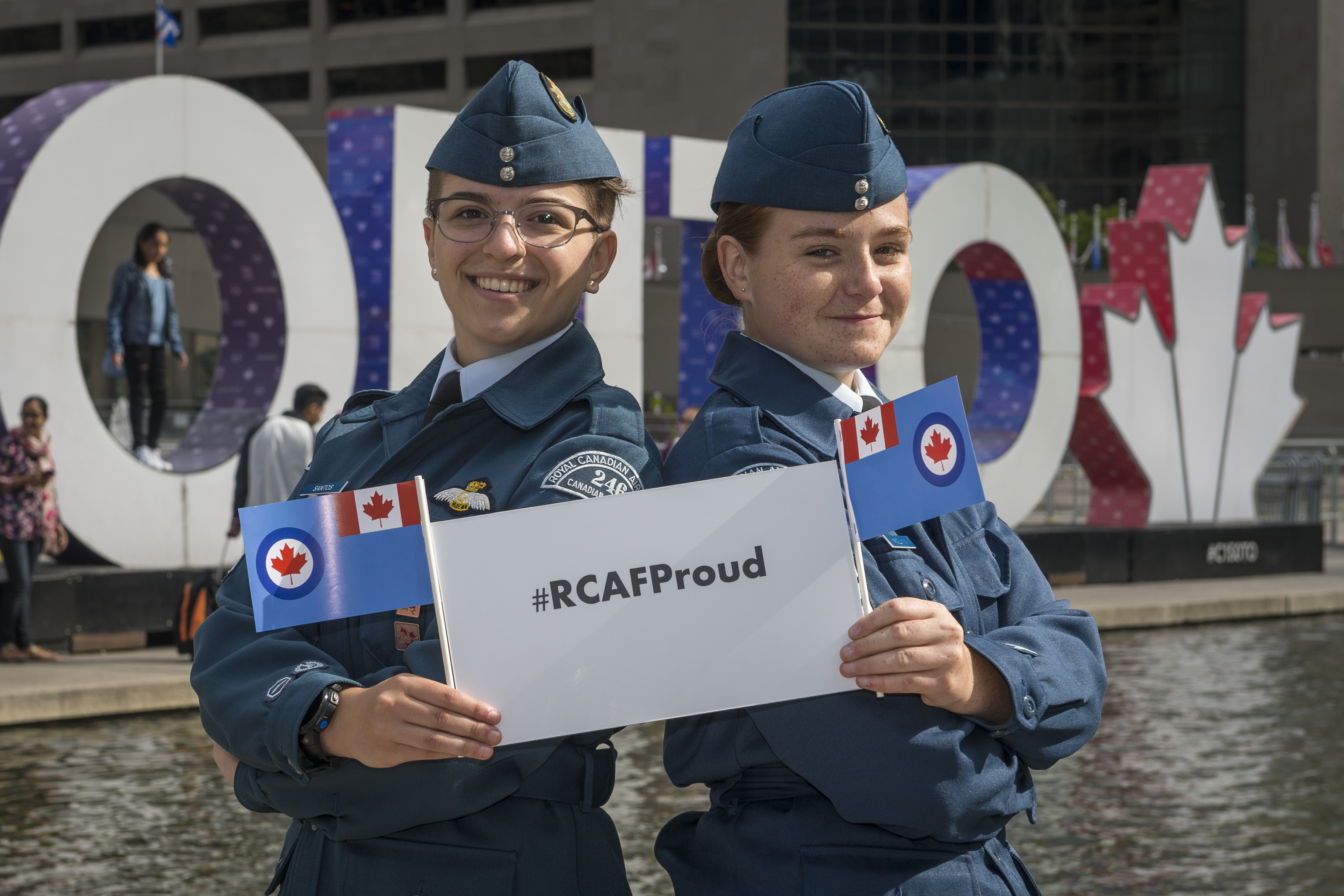 On August 31, 2017, Royal Canadian Air Force Cadets celebrate at the TORONTO sign at Nathan Phillips Square to mark the presentation of new Colours to the RCAF on September 1, also at Nathan Phillips Square. #RCAFProud PHOTO: Corporal Alana Morin, FA03-2017-0109-027