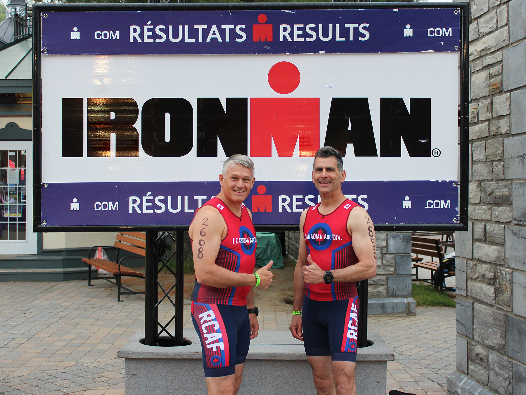 "Major-General Christian Drouin, Commander 1 CAD/CANR (left) and former Division Chief Warrant Officer Mike Scarcella display their numbers before the gruelling 2017 Ironman Mont-Tremblant 70.3 Triathlon, dubbed the ""1 CAD Command Team Challenge"". PHOTO: Submitted"