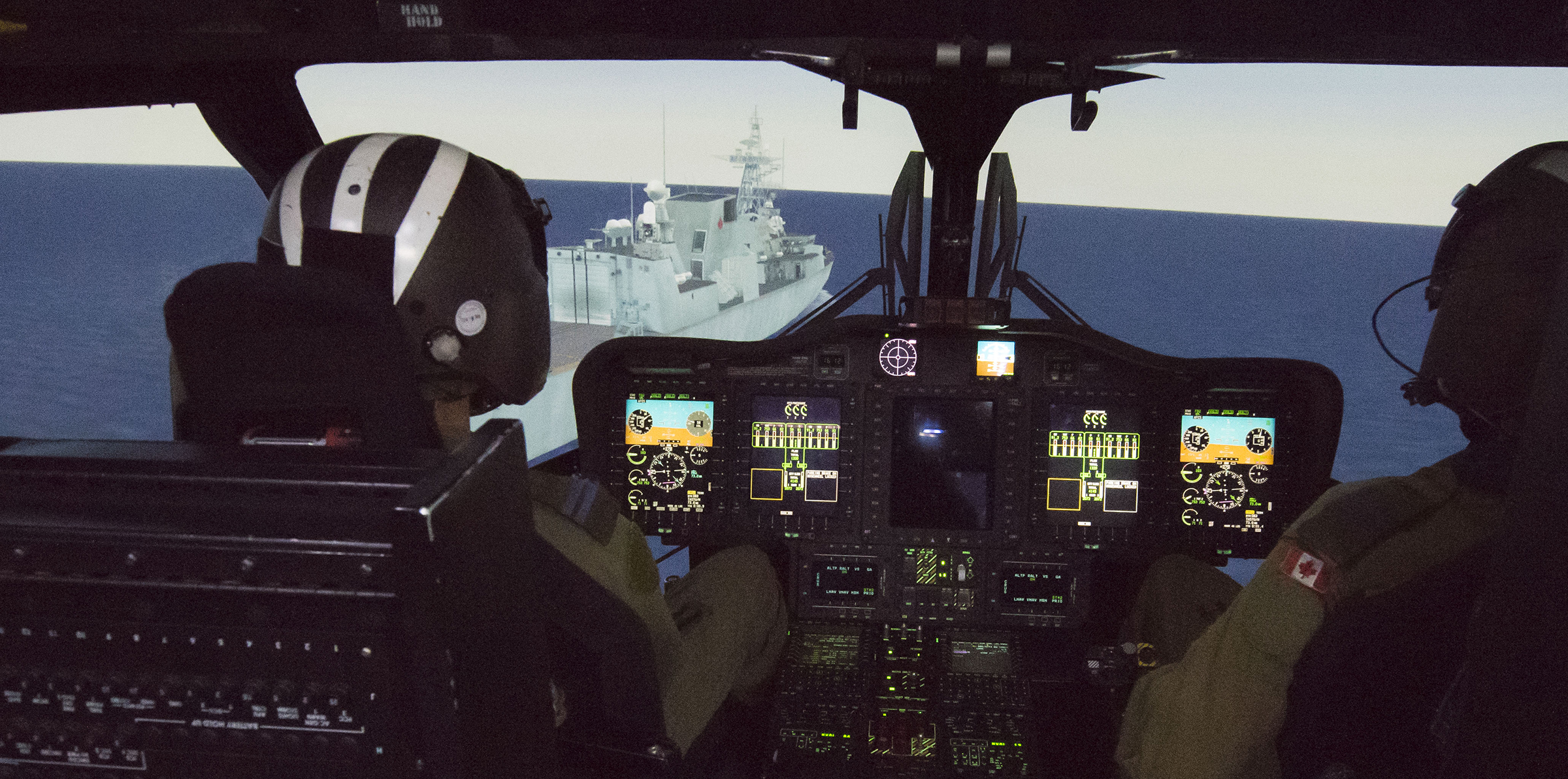 Captain Jean Martin and Captain Craig Law conduct training in the CH-148 Cyclone operational mission simulator on September 15, 2017. PHOTO: Leading Seaman Brad Upshall, SW06-2017-0284-008
