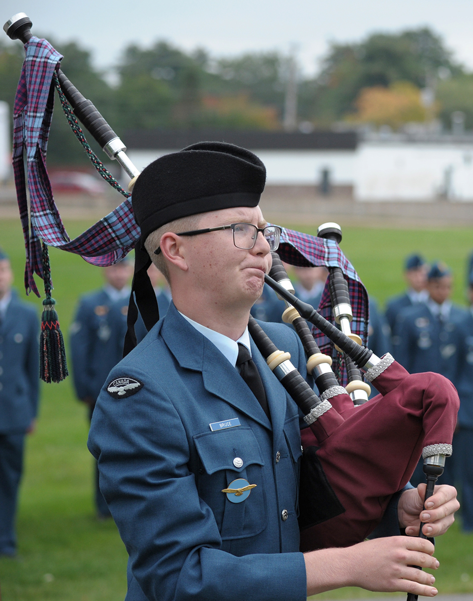 Aviator Brad Bruce, from the Pipes and Drums of 14 Wing Greenwood, pipes the lament on September 17, 2017, during the Battle of Britain parade at the 107 Royal Canadian Air Force Association in Greenwood, Nova Scotia. PHOTO: Master Corporal Rory Wilson, GD14-2017-0555-008