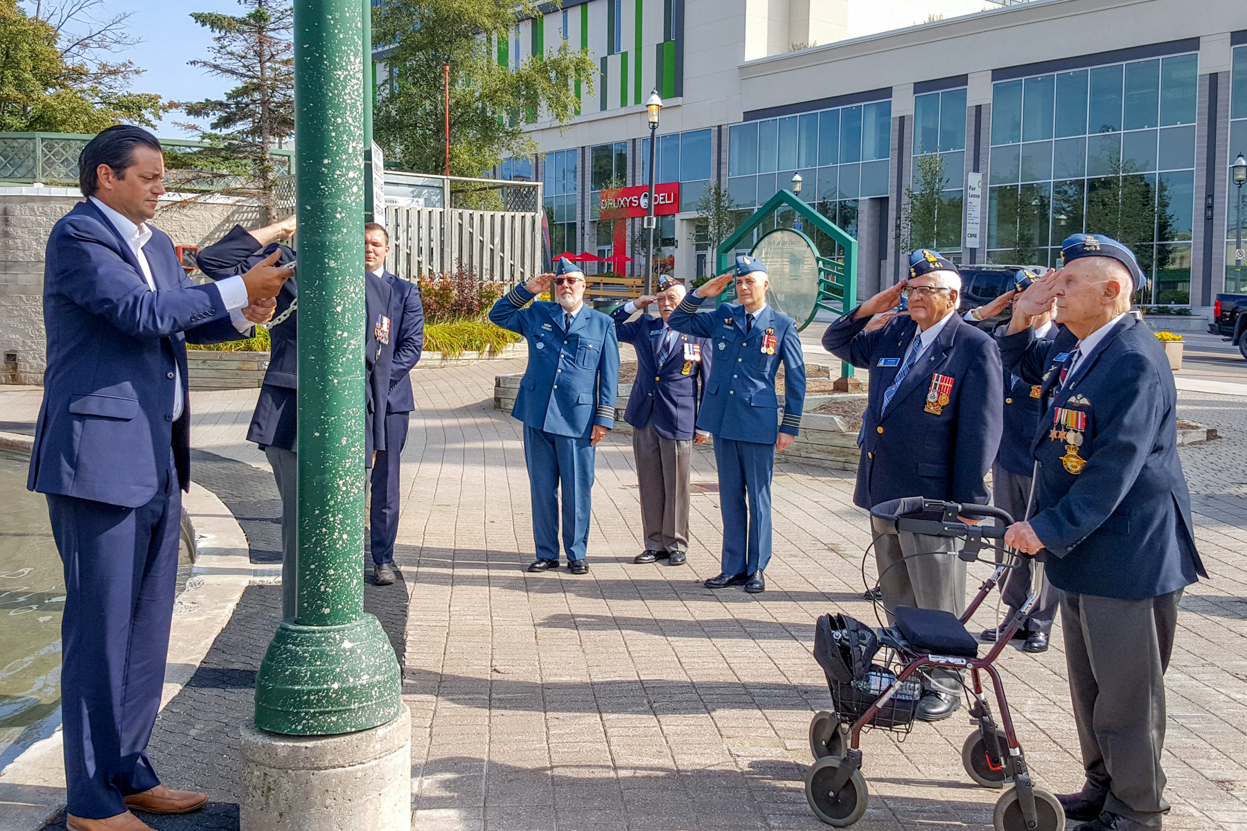 Royal Canadian Air Force members and veterans salute on September 13, 2017, as Barrie, Ontario, Mayor Jeff Lehman raises the Royal Canadian Air Force flag at Barrie City Hall in commemoration of the Battle of Britain. PHOTO: Corporal Aydyn Neifer, BM03-2017-0313-09
