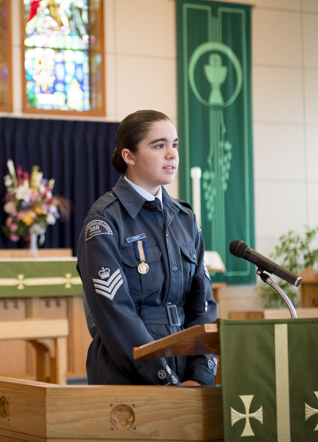 In St. Michael and All Angels Chapel in Comox, British Columbia, Master Corporal Power, from 386 Komox Royal Canadian Air Cadet Squadron, addresses the congregation during the September 17, 2017, Battle of Britain service. PHOTO: Master Seaman Roxanne Wood, CX04-2017-0355-009