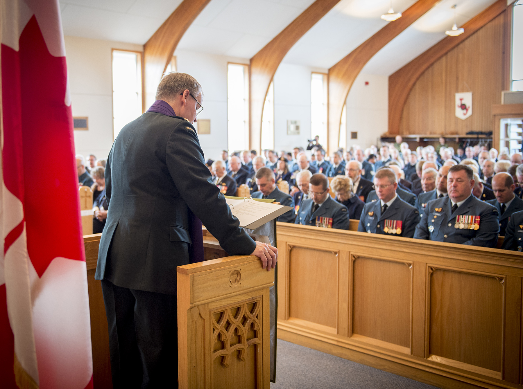 Major Bastien Leclerc offers a prayer during the 19 Wing Battle of Britain service held September 17, 2017, in St. Michael and All Angels Chapel in Comox, British Columbia. PHOTO: Master Seaman Roxanne Wood, CX04-2017-0355-007