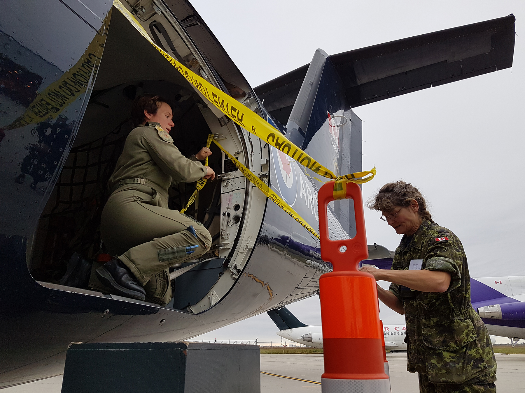 "Major Geneviève Dussault and Captain Maxine Kapralik of 402 ""City of Winnipeg"" Squadron prepare for visitors during Girls in Aviation Day on September 23, 2017, at Stevenson Campus of Red River College in Winnipeg, Manitoba. PHOTO: Captain Bettina McCulloch-Drake, 20170923-081254"