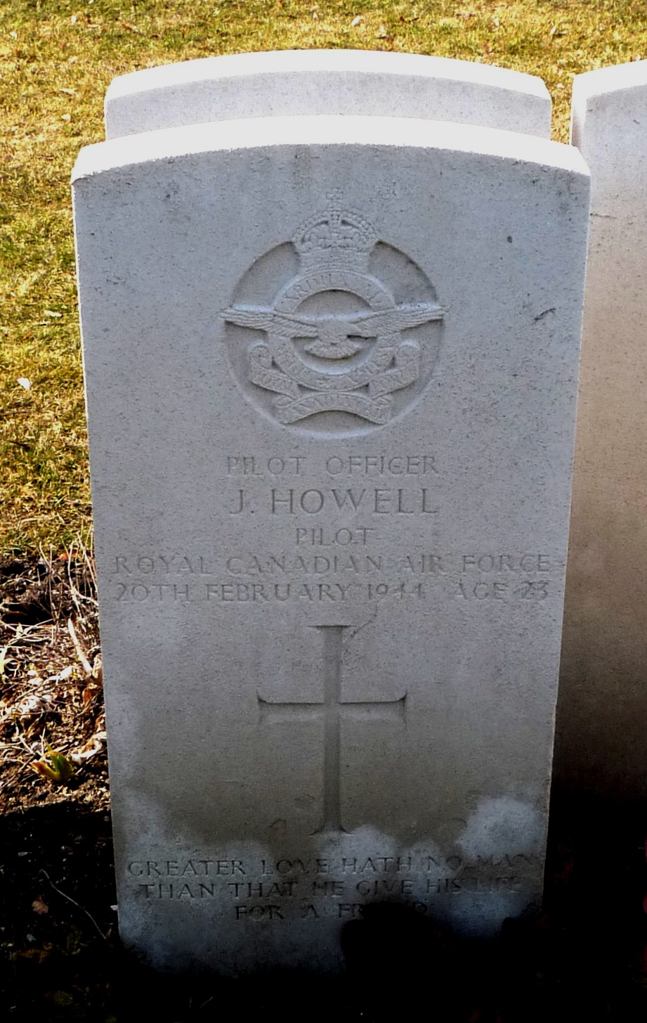 The headstone of Pilot Officer James Howell at the Berlin War Cemetery.  Standard headstones such as this, bearing the badge of the armed force with which the individual served, are used at cemeteries overseas and in Canada. PHOTO: Uwe Jenrich via internet