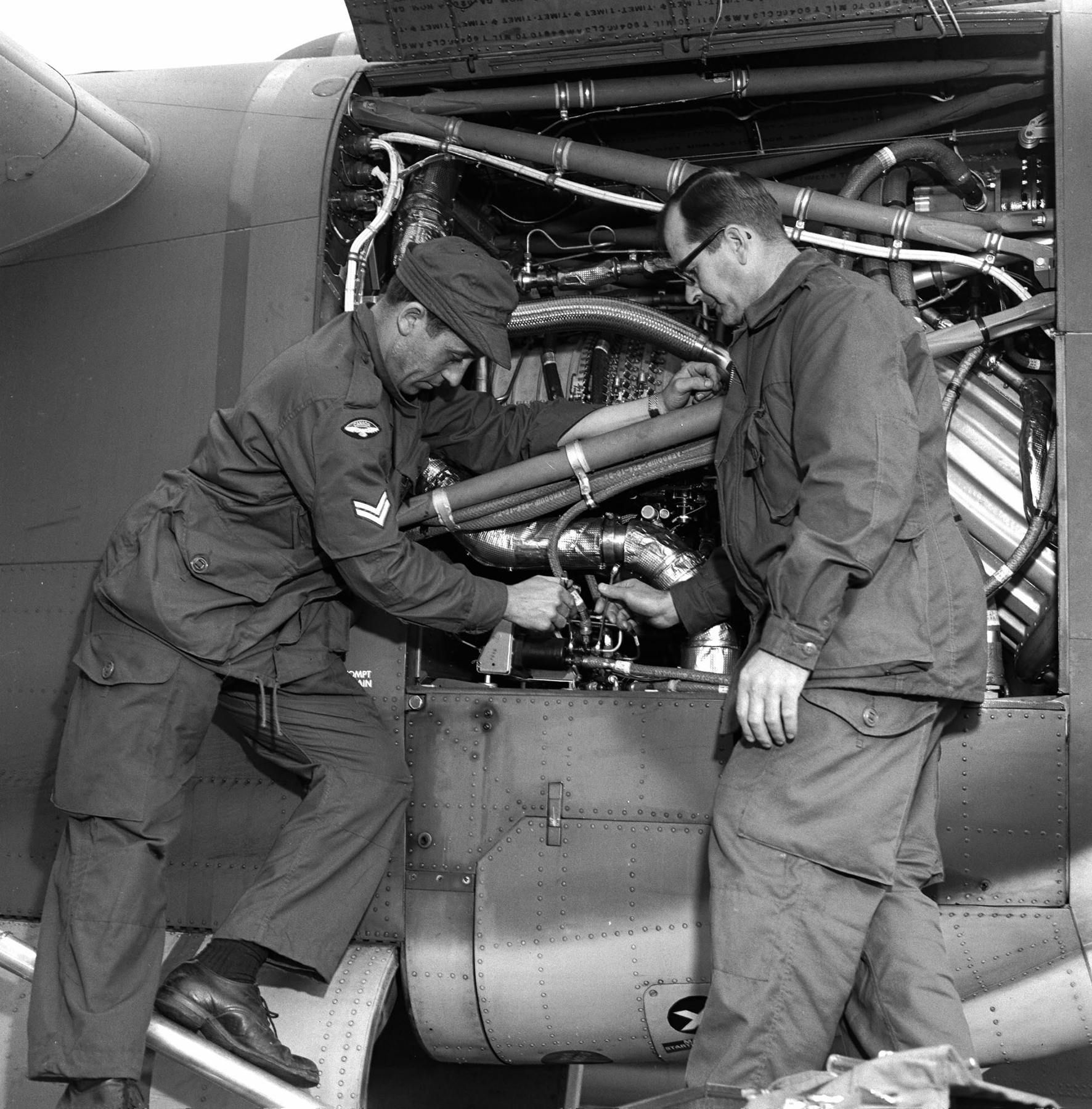 Corporal Andre Brown and Corporal Rolly Hains, of 429 (Aircraft Activity) Squadron, check the engine of a CC-115 Buffalo aircraft on May 15, 1968, during Exercise New Shakedown. PHOTO: DND Archives, CF68-42-6