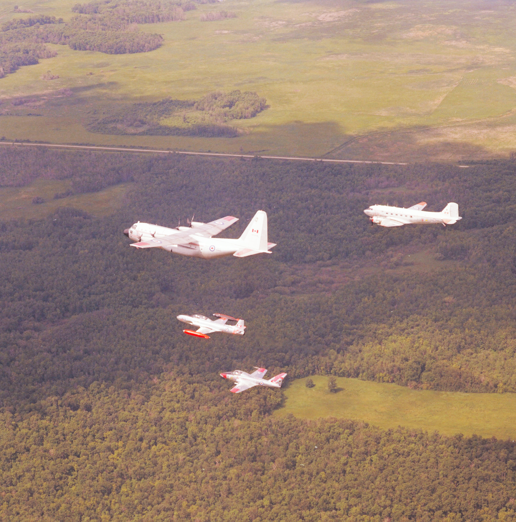 Aircraft used by 429 Bison Squadron for navigation training on June 15, 1978, include, from top, a CC-130 Hercules, a T-33 Silver Star and a CT-114 Tutor, all followed by a CC-129 Dakota. PHOTO: Warrant Officer J.F. Casey, DND Archives, IWC78-116