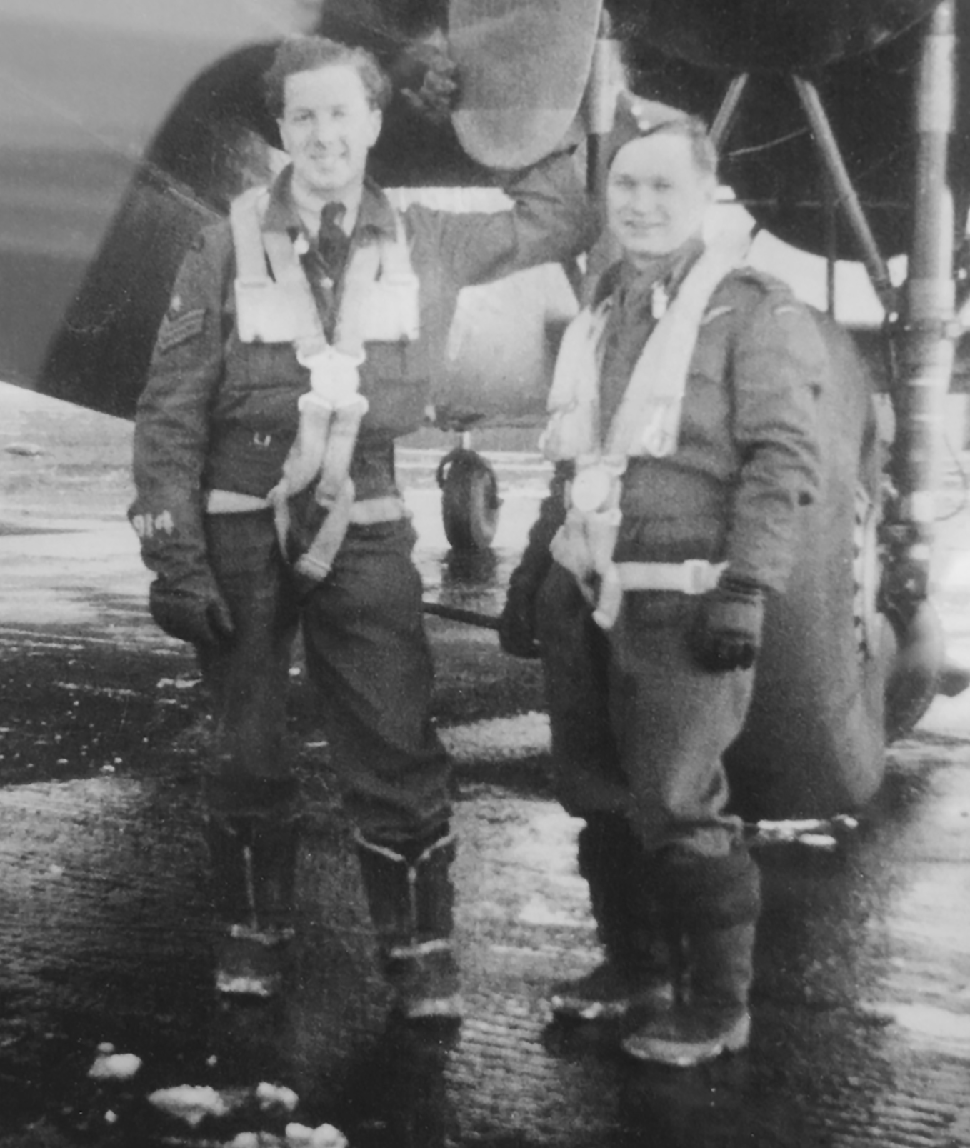 "Royal Air Force 90 Squadron ""Gladiators"" Roy Morrison, left, and Henry ""Chick"" Hewitt, stand with their Lancaster bomber during the Second World War. PHOTO: Submitted"