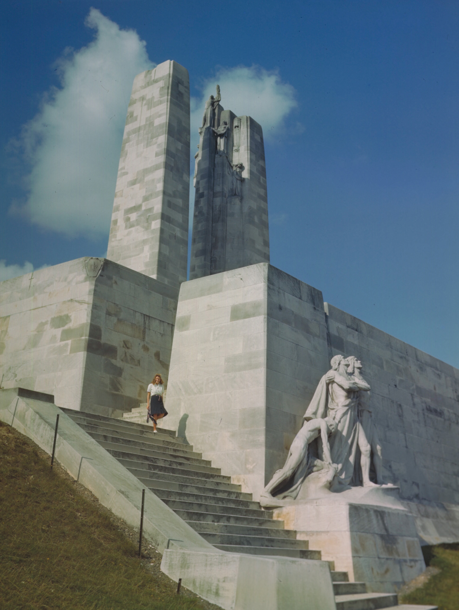"An undated photo of the Canadian National Vimy Memorial, showing the group of figures known as ""The Breaking of the Sword"". This group is on the southern corner of the front wall while a group called ""Sympathy of the Canadians for the Helpless"" is located at the northern corner. According to author Gordon Bolling, the two groups, known collectively as ""The Defenders"", represent the ideals for which Canadian gave their lives during the war; specifically ""The Breaking of the Sword"" represents the defeat of militarism and the general desire for peace (Source: Wikipedia). The sculpture helped inspire Honorary Colonel Loreena McKennitt's new single, ""Breaking of the Sword"". PHOTO: DND Archives, ZK-909-1"