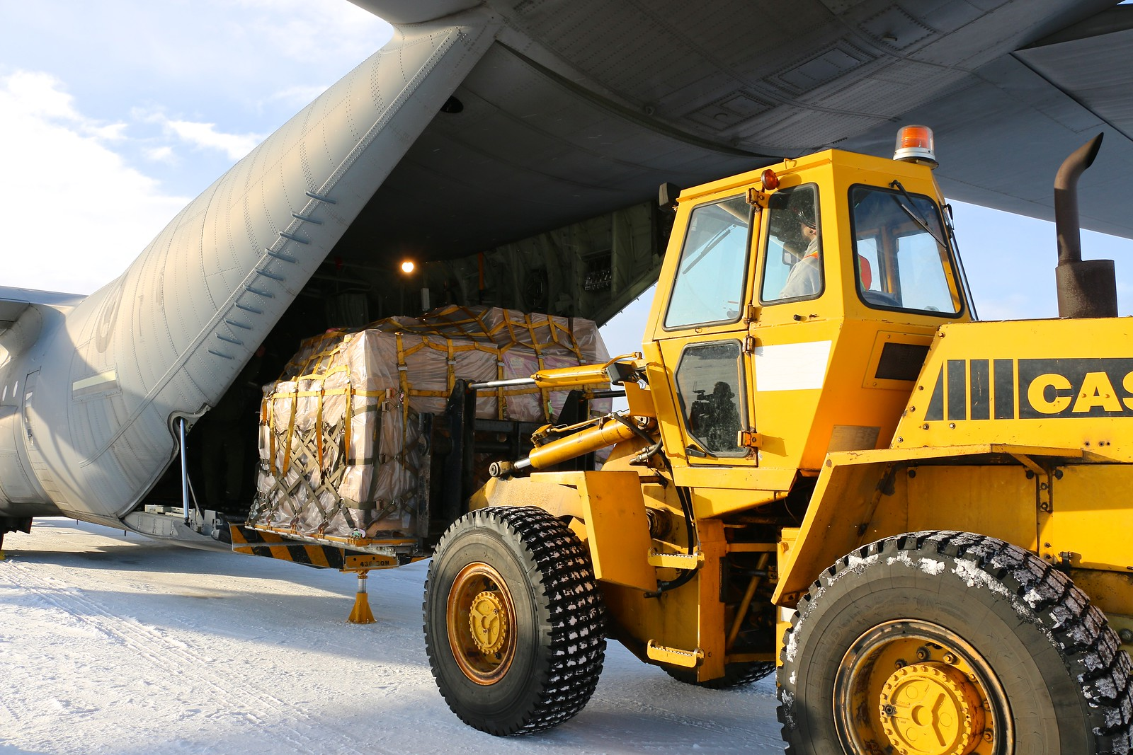 5 Wing Goose Bay personnel unload pallets of toys from the CC-130J Hercules. PHOTO: Makala Chapman