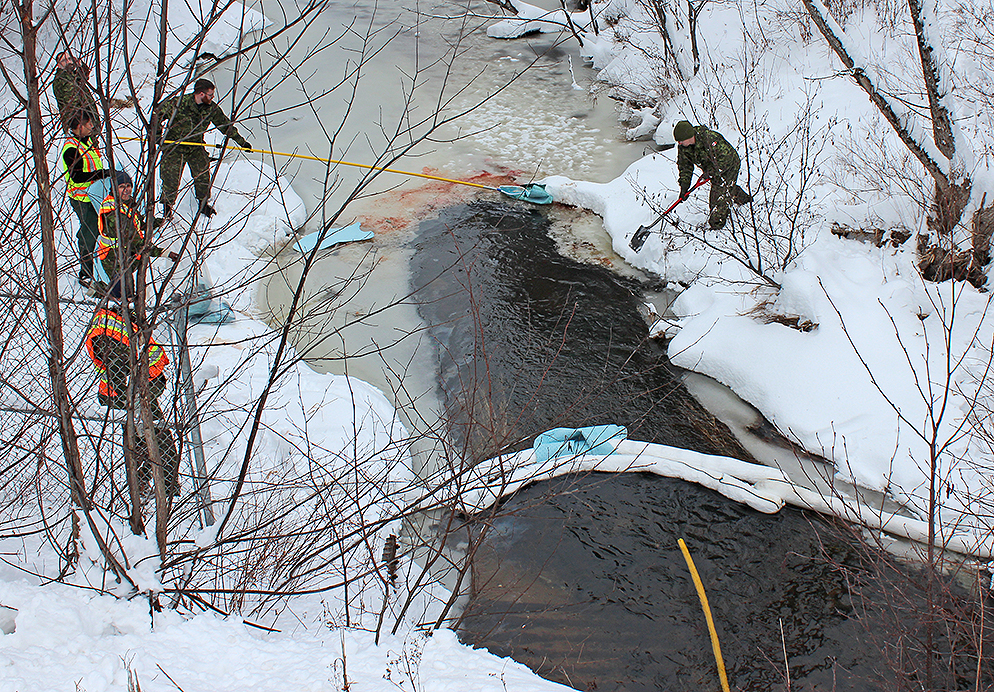 14 Wing Greenwood's damage control team and wing environment section clean up a non-base related fuel spill after a truck overturned in Zeke's Brook, which flows through the base further downstream. PHOTO: Submitted