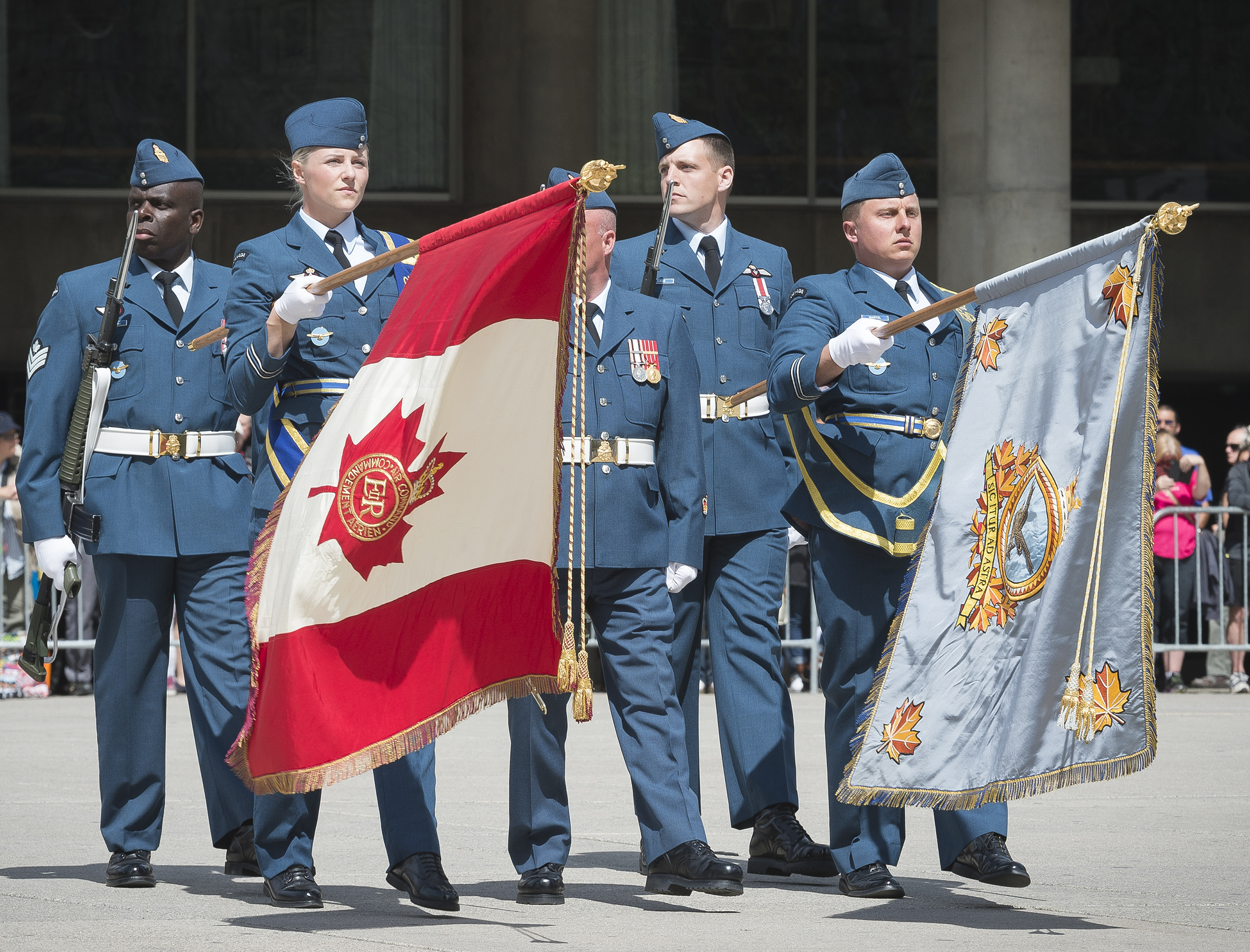 The retired Air Command Colours are paraded for the last time on September 1, 2017, at Nathan Phillips Square in Toronto. The Queen's Colour (left) is carried by Captain Emily Nissen and the Air Command Colour is carried by Captain Louis Martel. Both are from 402 Squadron, Winnipeg. PHOTO: Sergeant Johanie Maheu, Rideau Hall © OSGG, GG05-2017-0309-042