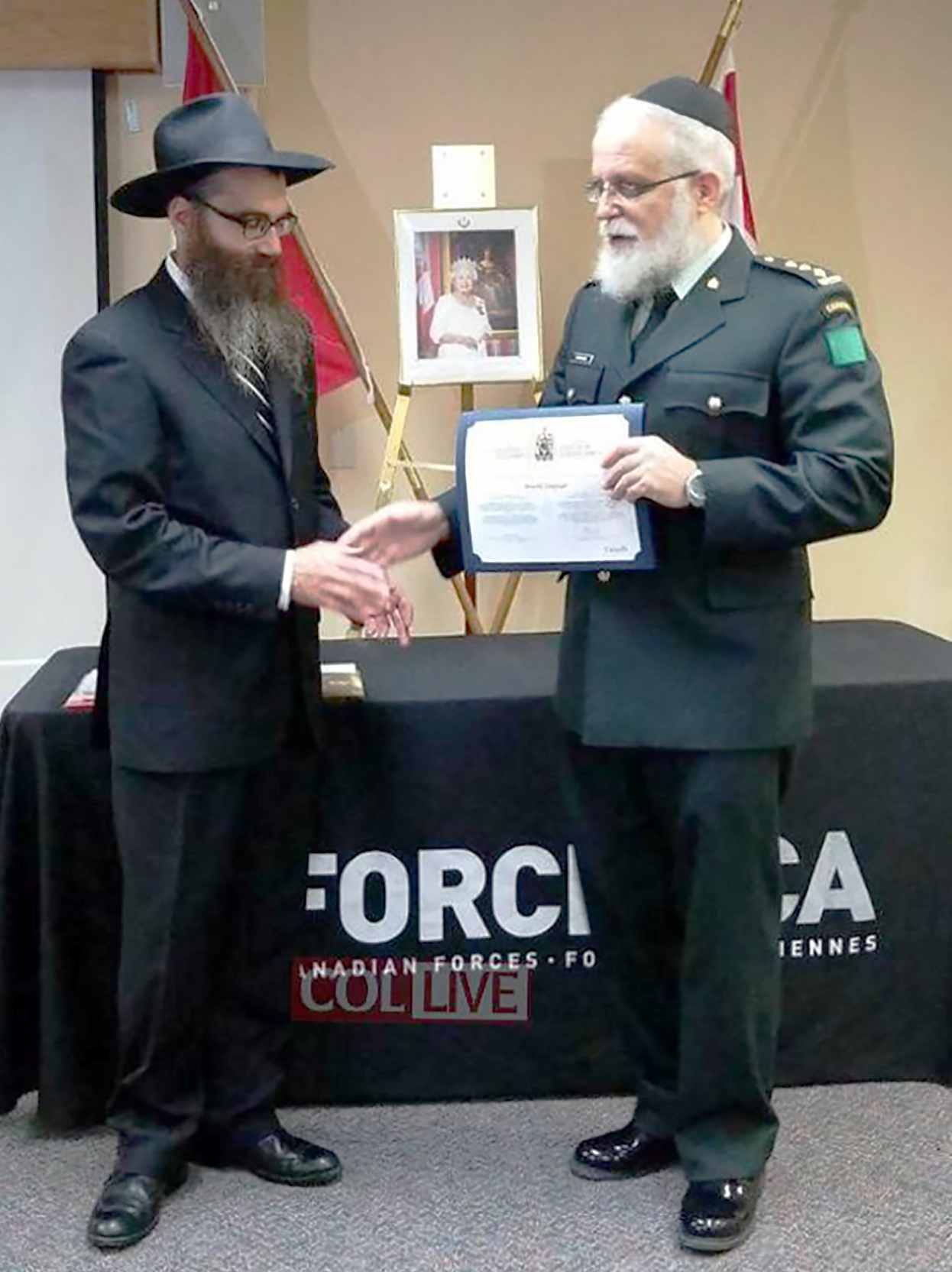 Rabbi Noteh Glogauer (left) becomes a chaplain with the rank of captain in the Royal Canadian Air Force in an attesting ceremony officiated by 4th Canadian Division Chaplain Captain (Rabbi) Lazer Danzinger. The ceremony was held November 29, 2017, at the Canadian Armed Forces Recruiting Centre in Toronto, Ontario. PHOTO: http://www.collive.com