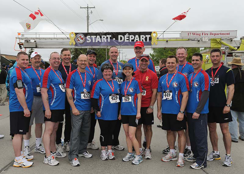 On May 29, 2011, Canadian Armed Forces chief warrant officers gather at the start/finish line of the RCAF Run at 17 Wing Winnipeg, Manitoba. PHOTO: Corporal Piotr Figiel, WG2011-0199-31