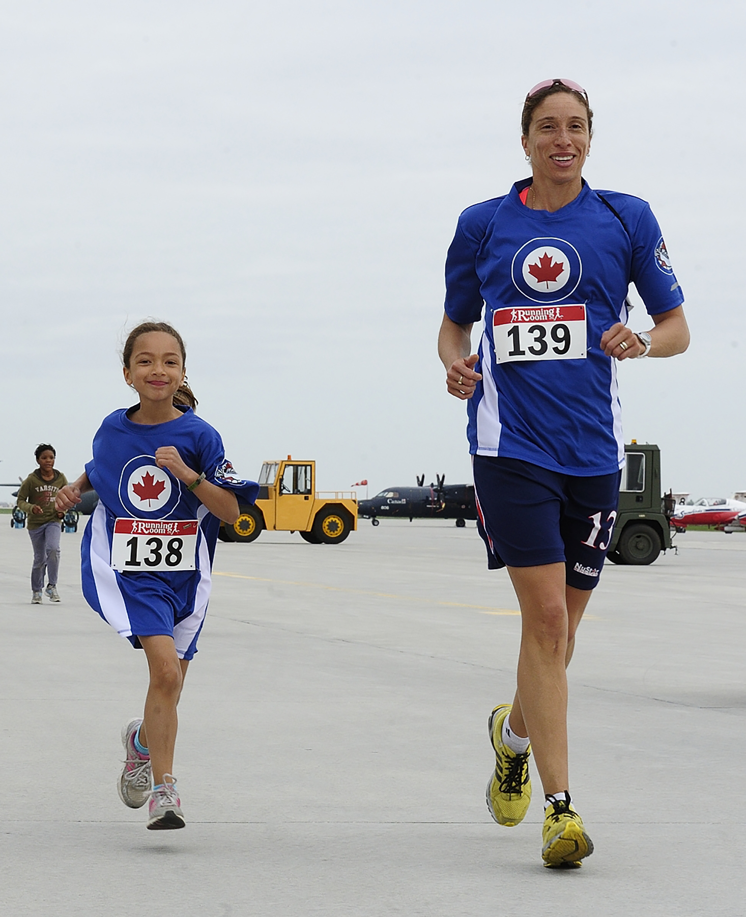 Saba Harding and her mom, Sharlene Harding, run along the flight line during the May 26, 2013, RCAF Run at 17 Wing Winnipeg, Manitoba. PHOTO: Master Corporal Colin Aitken, WG2013-0212-48