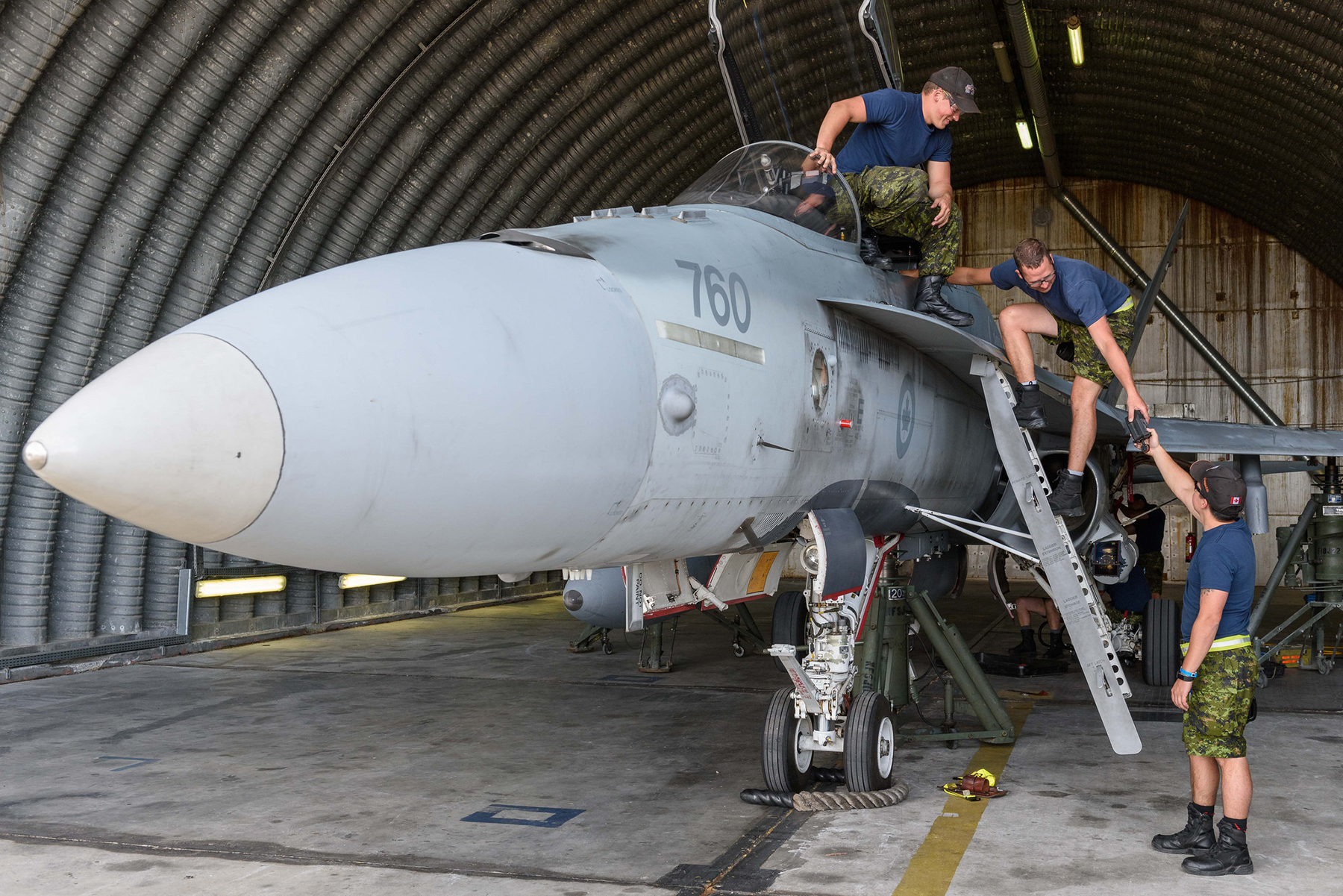 "On September 19, 2017, during Exercise Serpentex 2017, maintenance personnel of the RCAF's 433 Tactical Fighter Squadron perform maintenance on a CF-188 Hornet in a hangar at Air Base 126 ""Captain Preziosi"", Ventiseri-Solenzara, in Corsica, France. PHOTO: Master Corporal Louis Brunet, BN53-2017-0002-012 [This image was digitally modified for reasons of operational security]"
