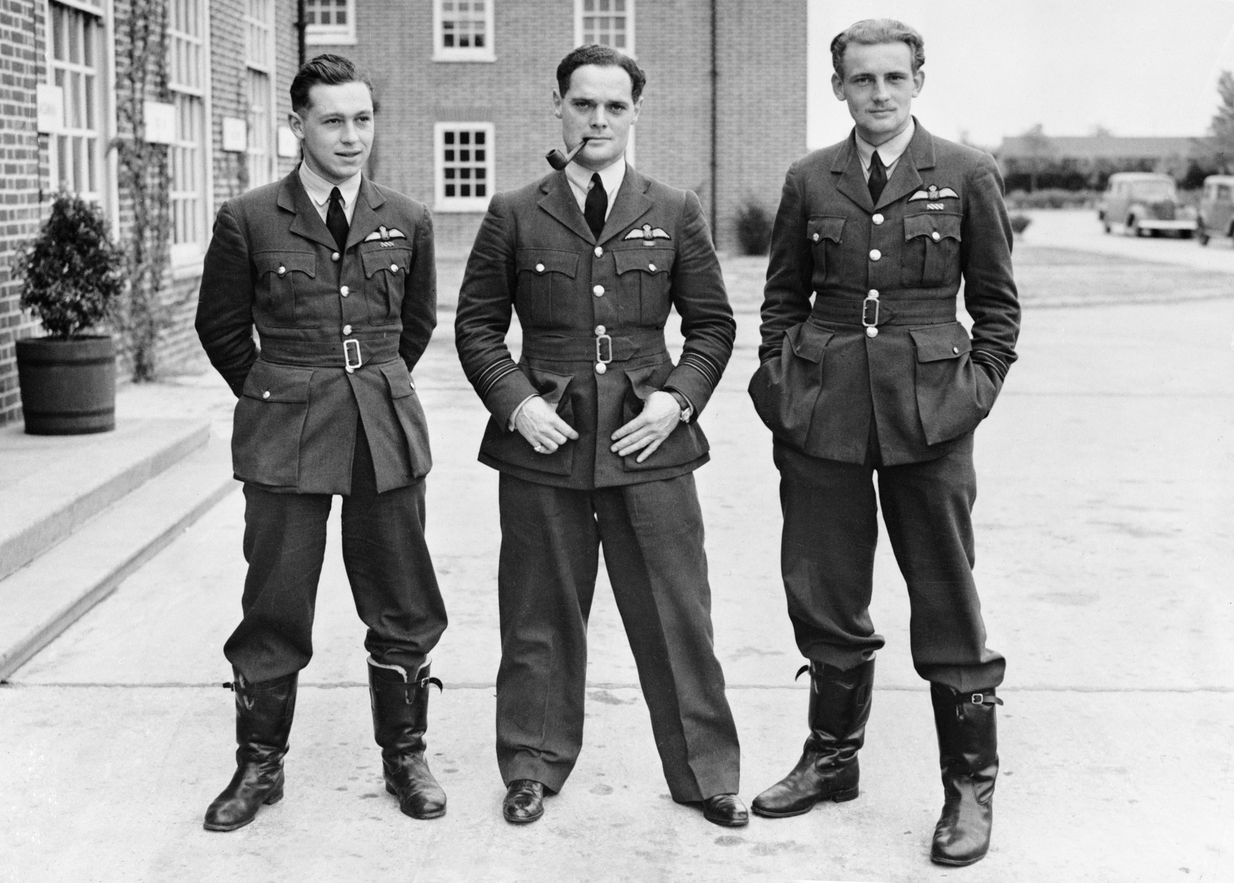 "Pilot Officer William McKnight (Canadian) (left), Squadron Leader Douglas Bader (British) (centre) and Flight Lieutenant Eric Ball (British), all of the Royal Air Force's 242 ""Canadian"" Squadron, during the Second World War. PHOTO: © Imperial War Museum, CH 1342"